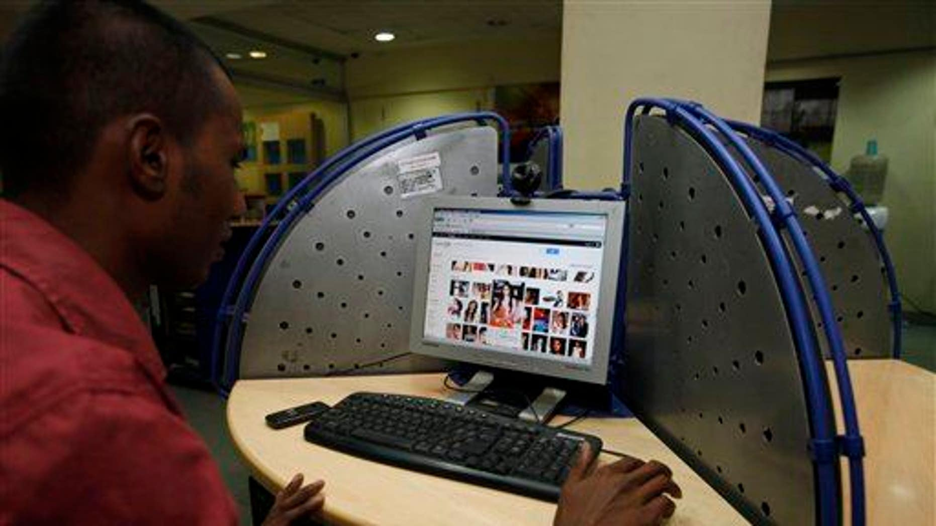 An Indian man surfs a Google page at an internet cafe in Hyderabad, India, Saturday, Jan. 14, 2012.