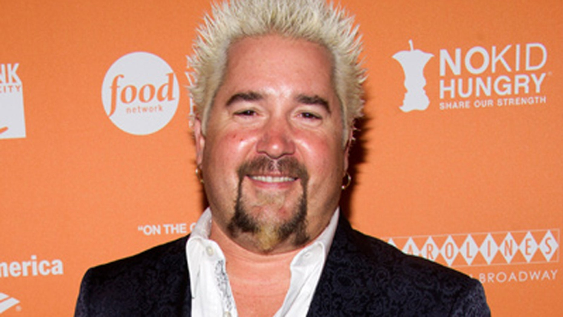 We  no longer have to image what Guy Fieri looks without his signature frosted spikes.