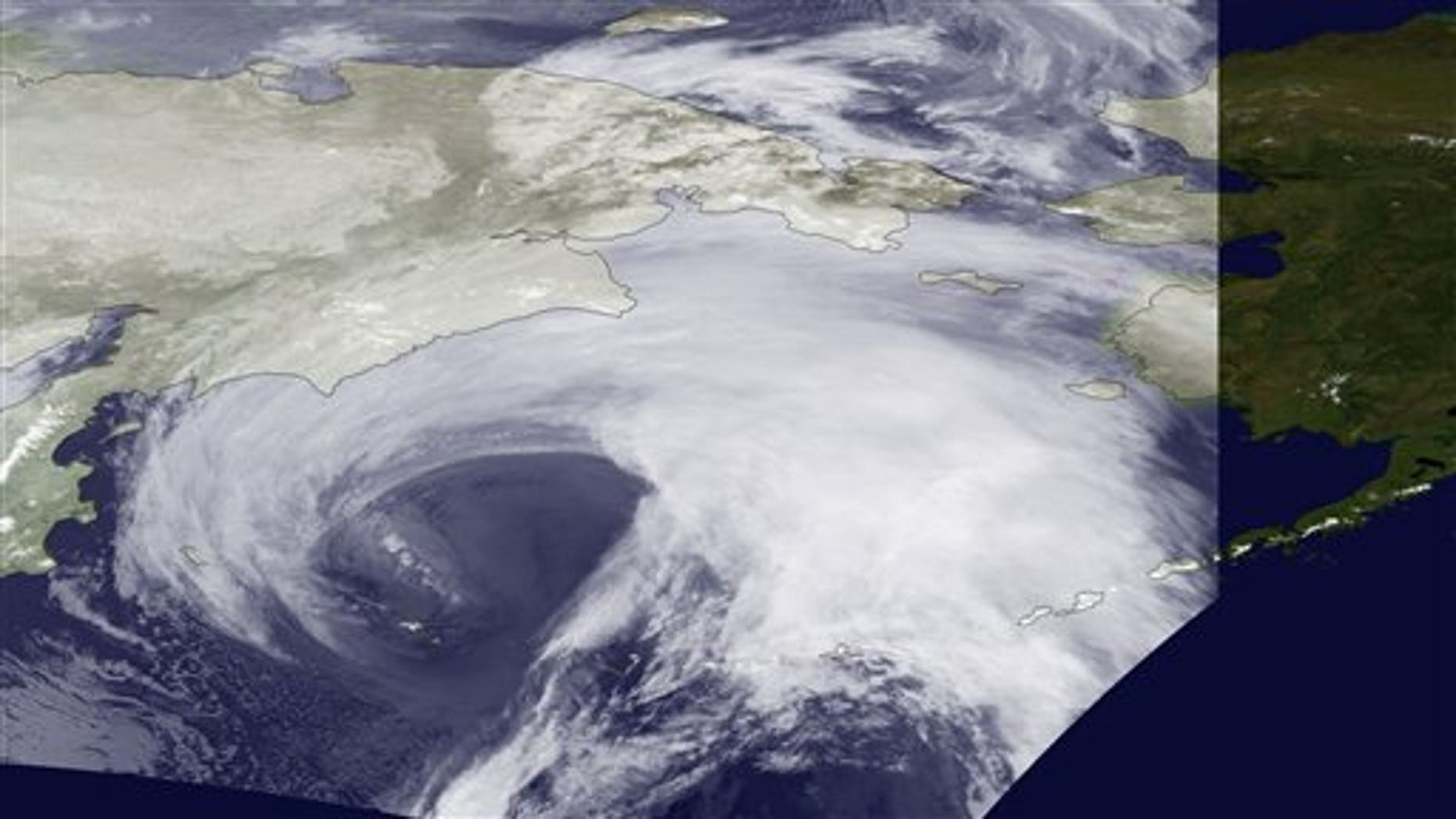 November 9, 2011: This image provided by the NOAA-19 satellite's AVHRR sensor, shows the storm bearing down on Alaska in this infrared imagery.