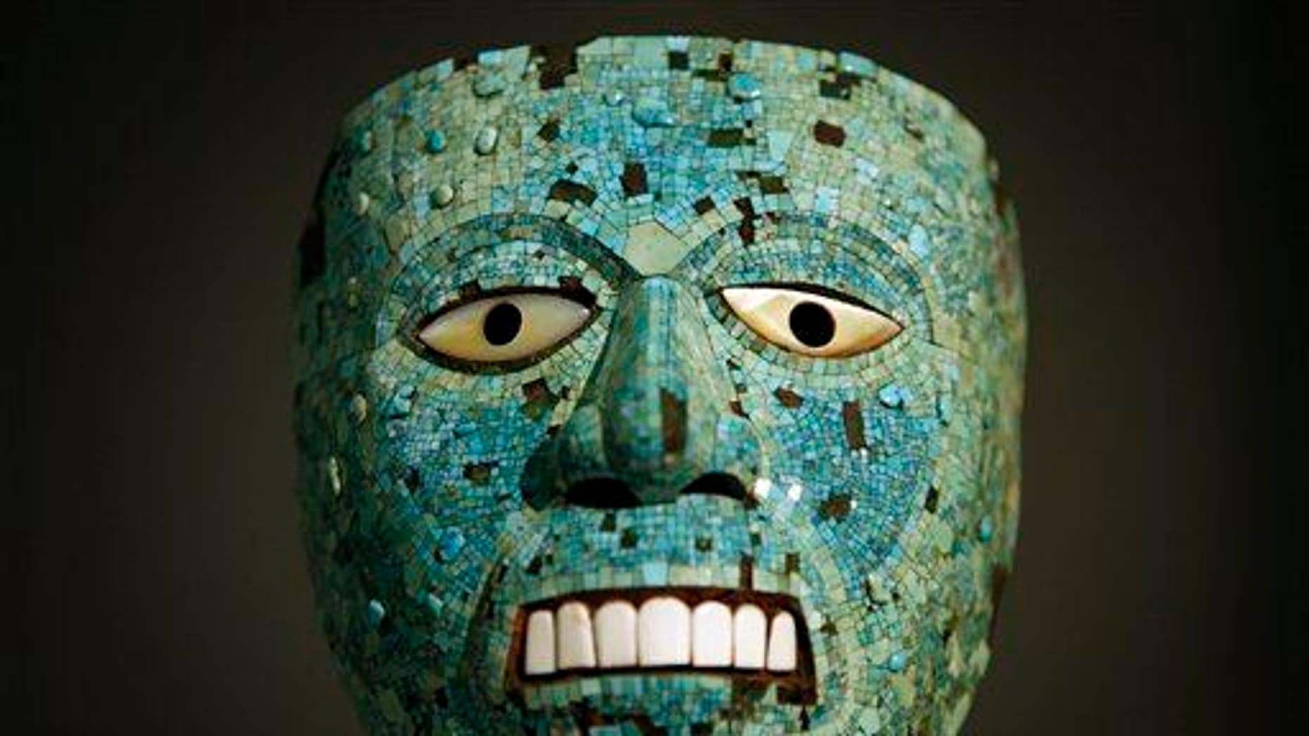 File photo of a turquoise mask, probably representing the sun god Tonatiuh, at a museum exhibit on the Aztecs.