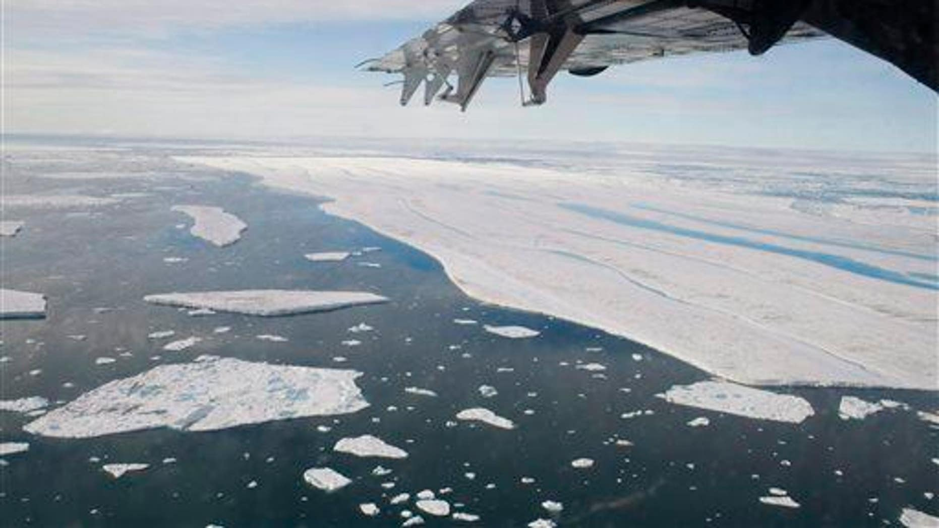 In this July 27, 2008 photo, a chunk of ice is shown drifting after it separated from the Ward Hunt Ice Shelf off the north coast of Ellesmere Island in Canada's far north.