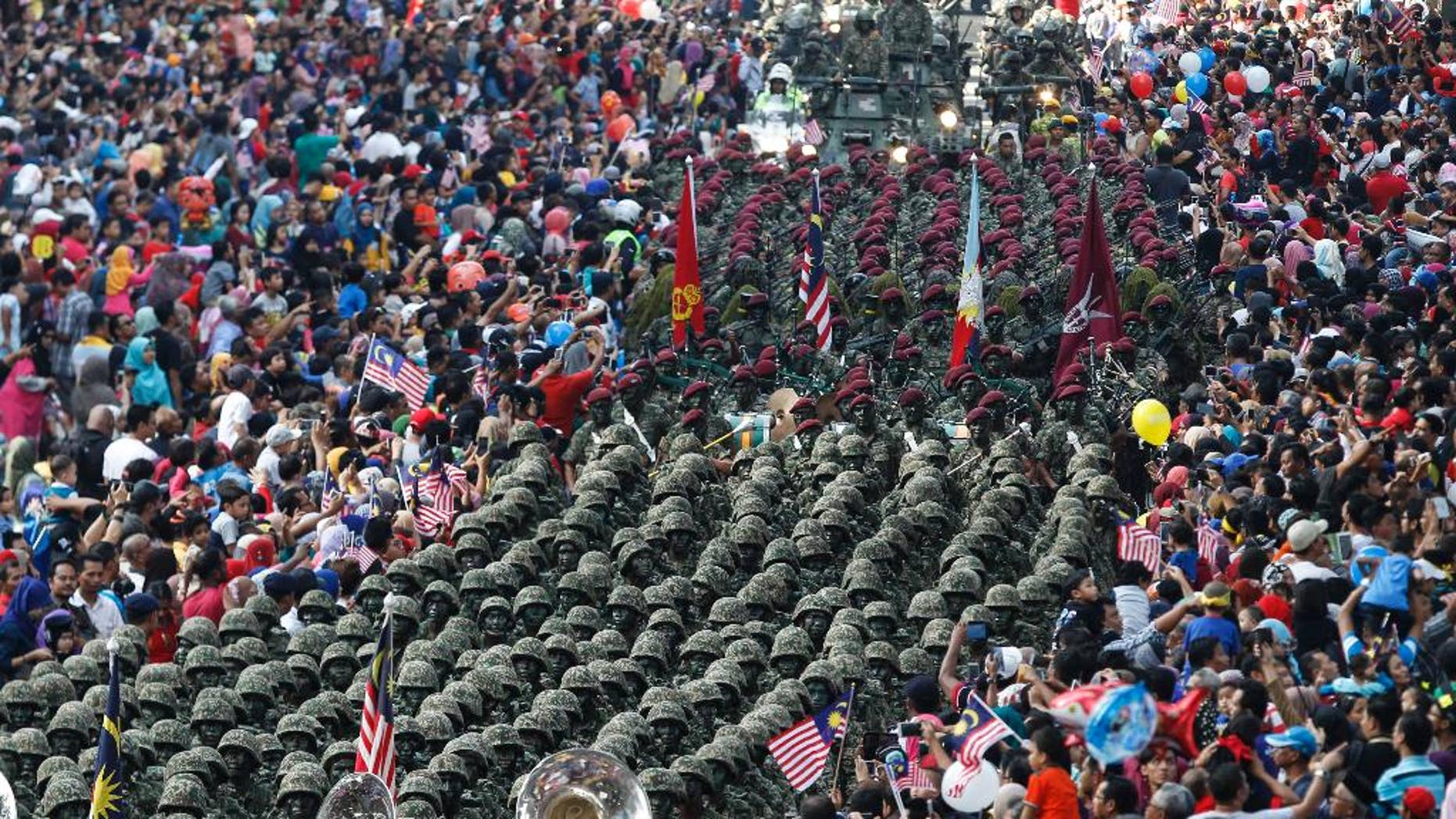 Malaysian Army personnel marching at the Independence Square in Kuala Lumpur Wednesday.
