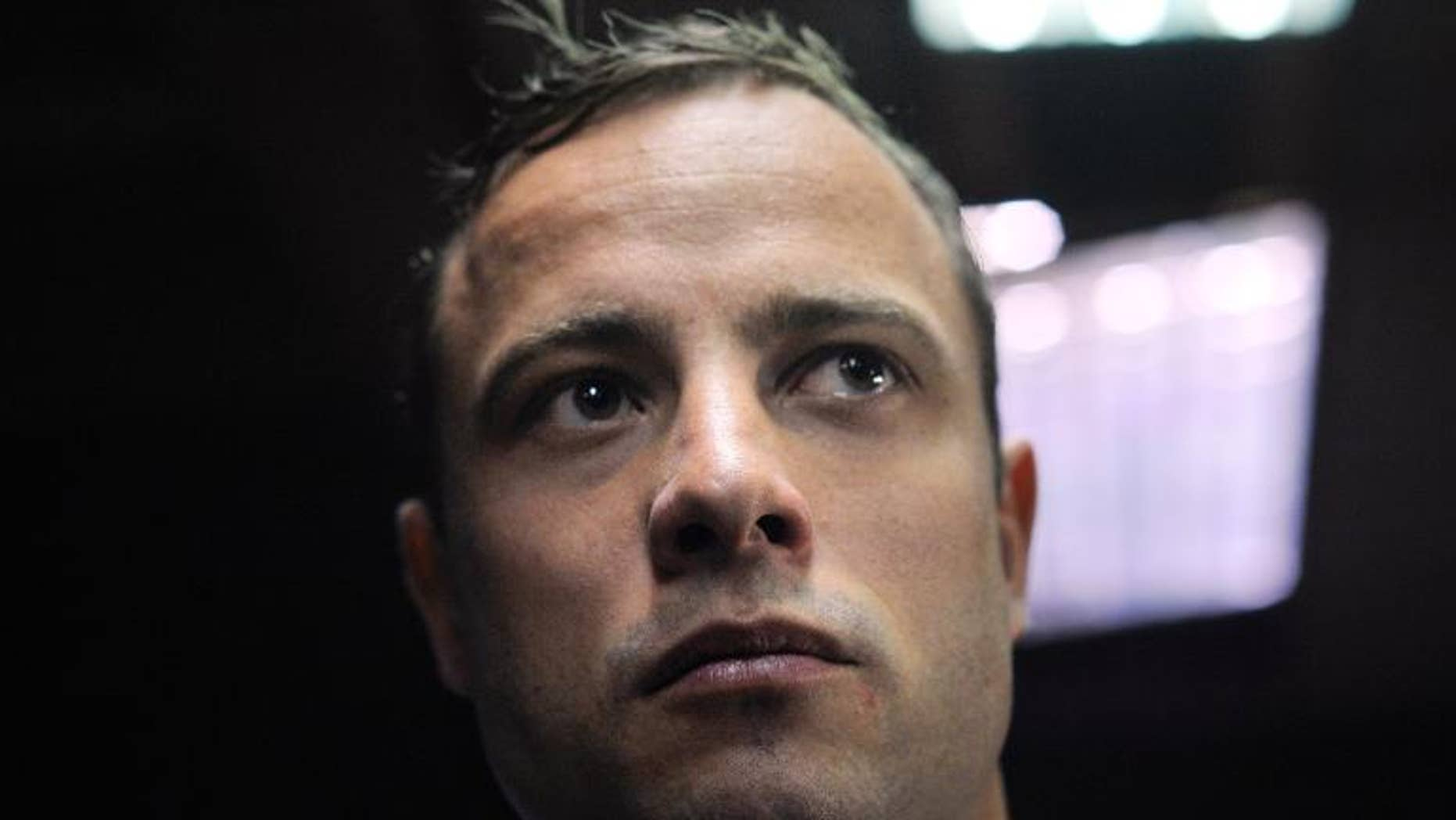South African Paralympic sprinter Oscar Pistorius stands in the Magistrate Court in Pretoria on June 4, 2013