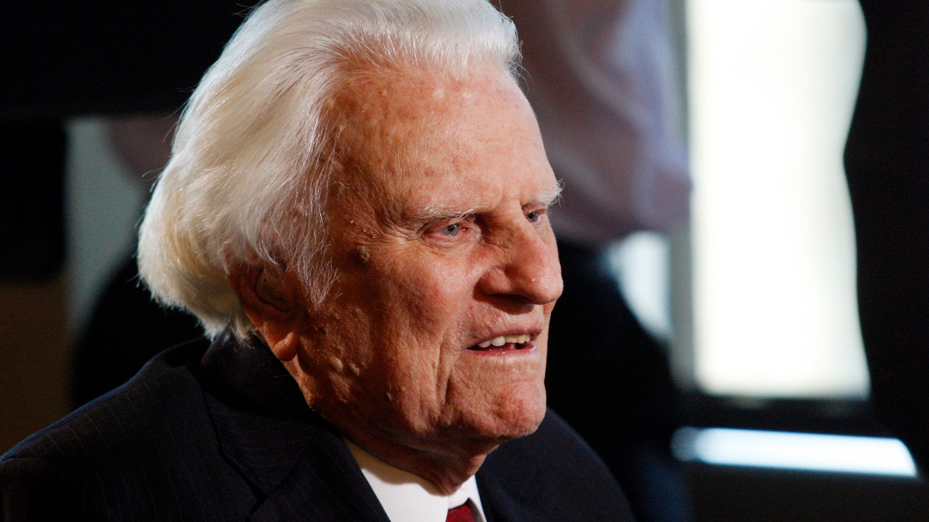 FILE - In this Dec. 20, 2010 file photo, evangelist Billy Graham, 92, speaks during an interview at the Billy Graham Evangelistic Association headquarters in Charlotte, N.C.    Graham, who transformed American religious life through his preaching and activism, becoming a counselor to presidents and the most widely heard Christian evangelist in history, has died. Spokesman Mark DeMoss says Graham, who long suffered from cancer, pneumonia and other ailments, died at his home in North Carolina on Wednesday, Feb. 21, 2018. He was 99. (AP Photo/Nell Redmond, File)