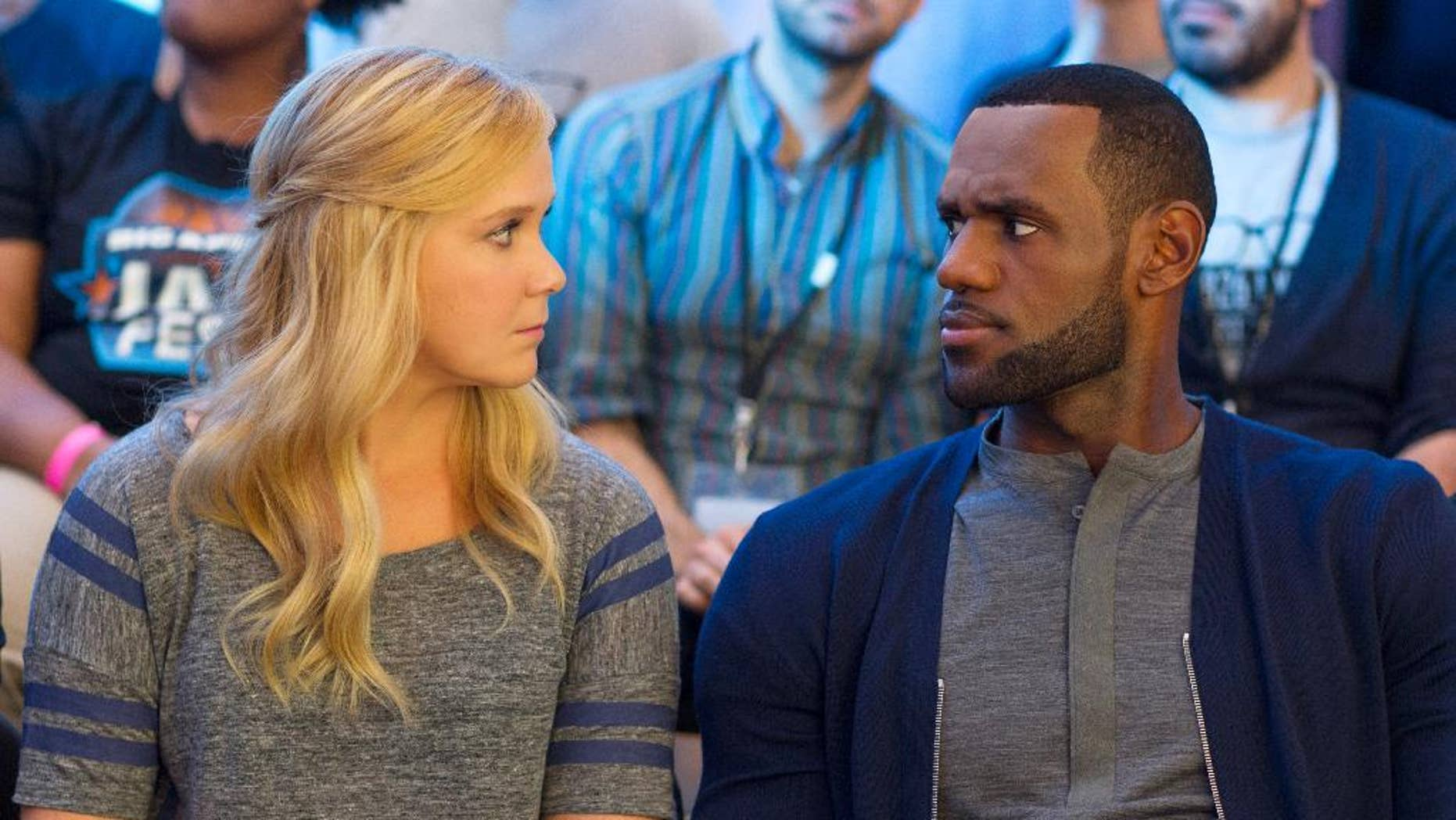 "Amy Schumer, left, and LeBron James in a scene from the comedy, ""Trainwreck."""
