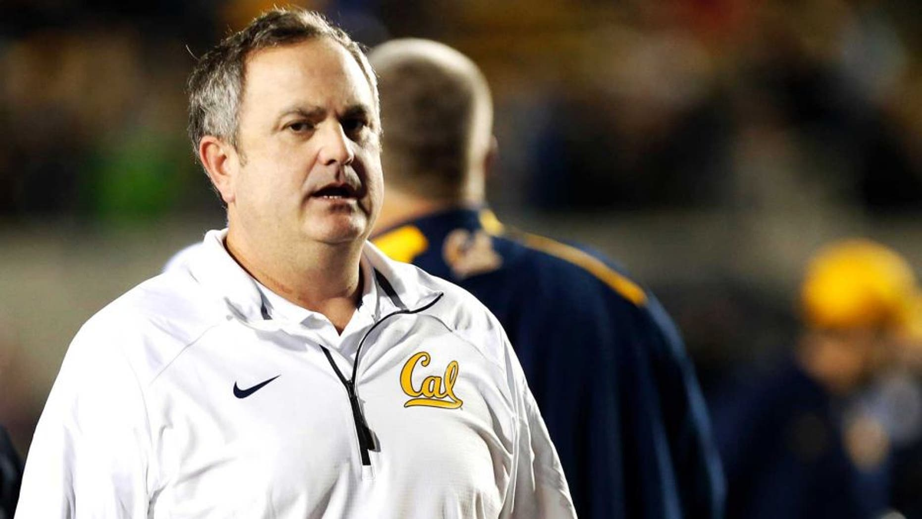 Nov 29, 2014; Berkeley, CA, USA; California Golden Bears head coach Sonny Dykes leaves the field after the loss against the Brigham Young Cougars at Memorial Stadium. The Brigham Young Cougars defeated the California Golden Bears 42-35. Mandatory Credit: Kelley L Cox-USA TODAY Sports