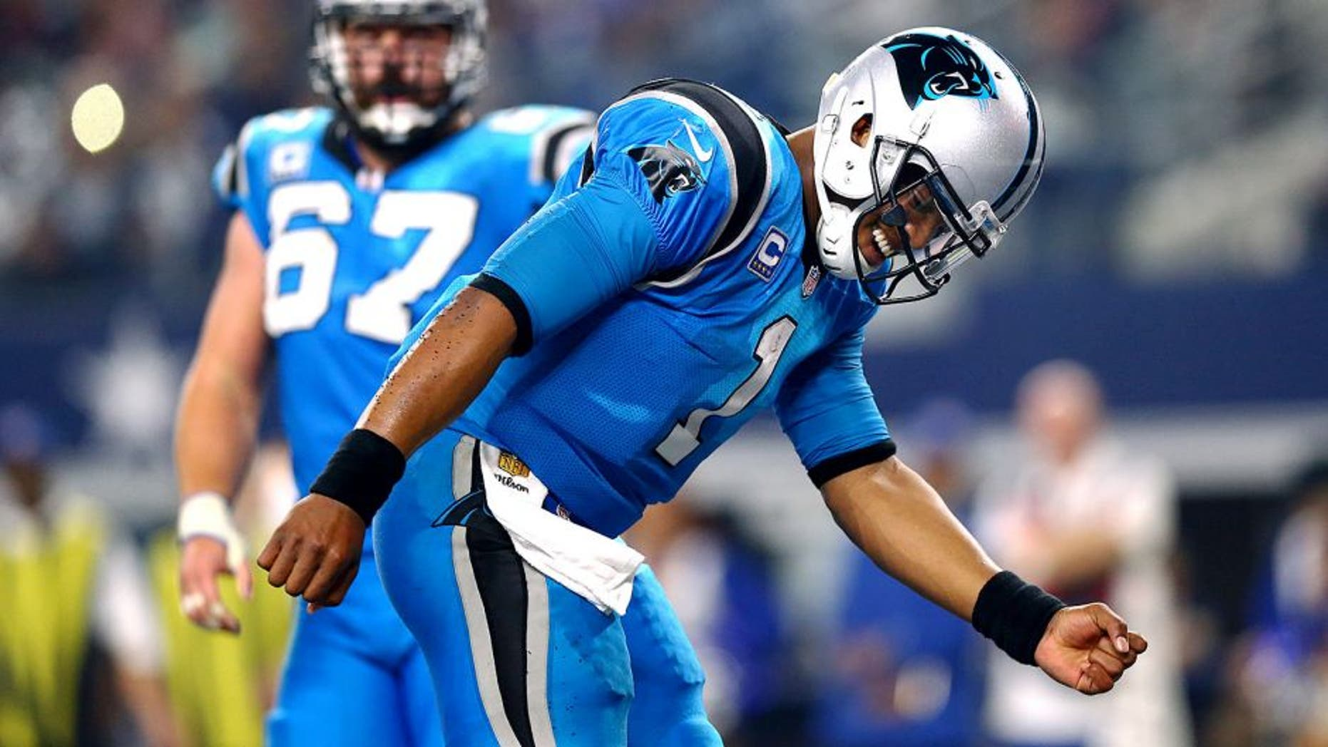 ARLINGTON, TX - NOVEMBER 26: Cam Newton #1 of the Carolina Panthers celebrates after scoring a touchdown against the Dallas Cowboys as teammate Ryan Kalil #67 looks on in the second half at AT&T Stadium on November 26, 2015 in Arlington, Texas. (Photo by Ronald Martinez/Getty Images)