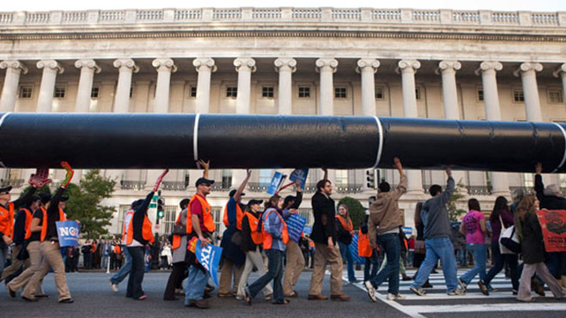 Nov. 6, 2011: Demonstrators carry a mock pipeline during an anti-Keystone rally in front of the White House in Washington.