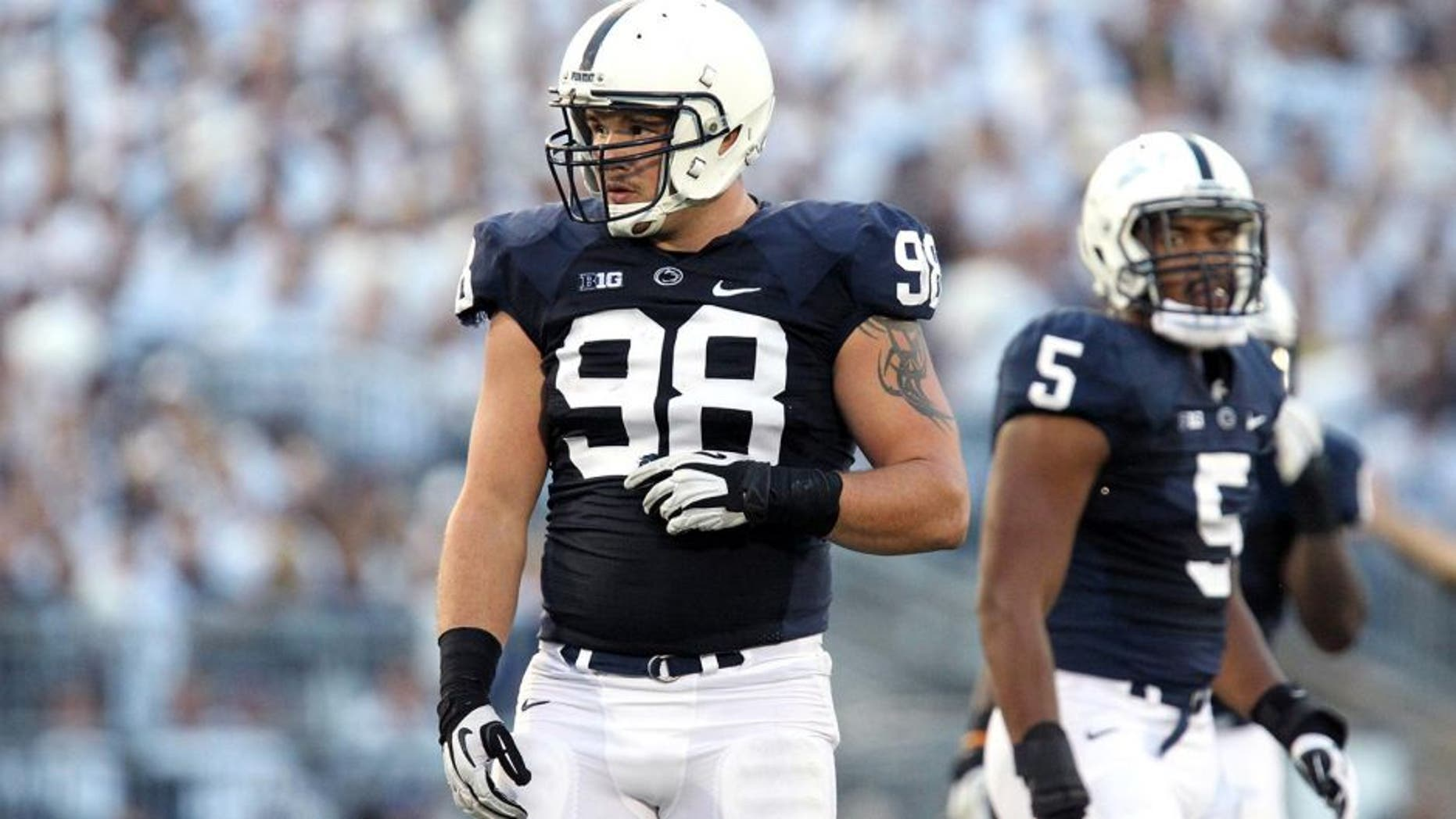 Oct 12, 2013; University Park, PA, USA; Penn State Nittany Lions defensive end Anthony Zettel (98) during the second quarter against the Michigan Wolverines at Beaver Stadium. Penn State defeated Michigan 43-40 in overtime. Mandatory Credit: Matthew O'Haren-USA TODAY Sports