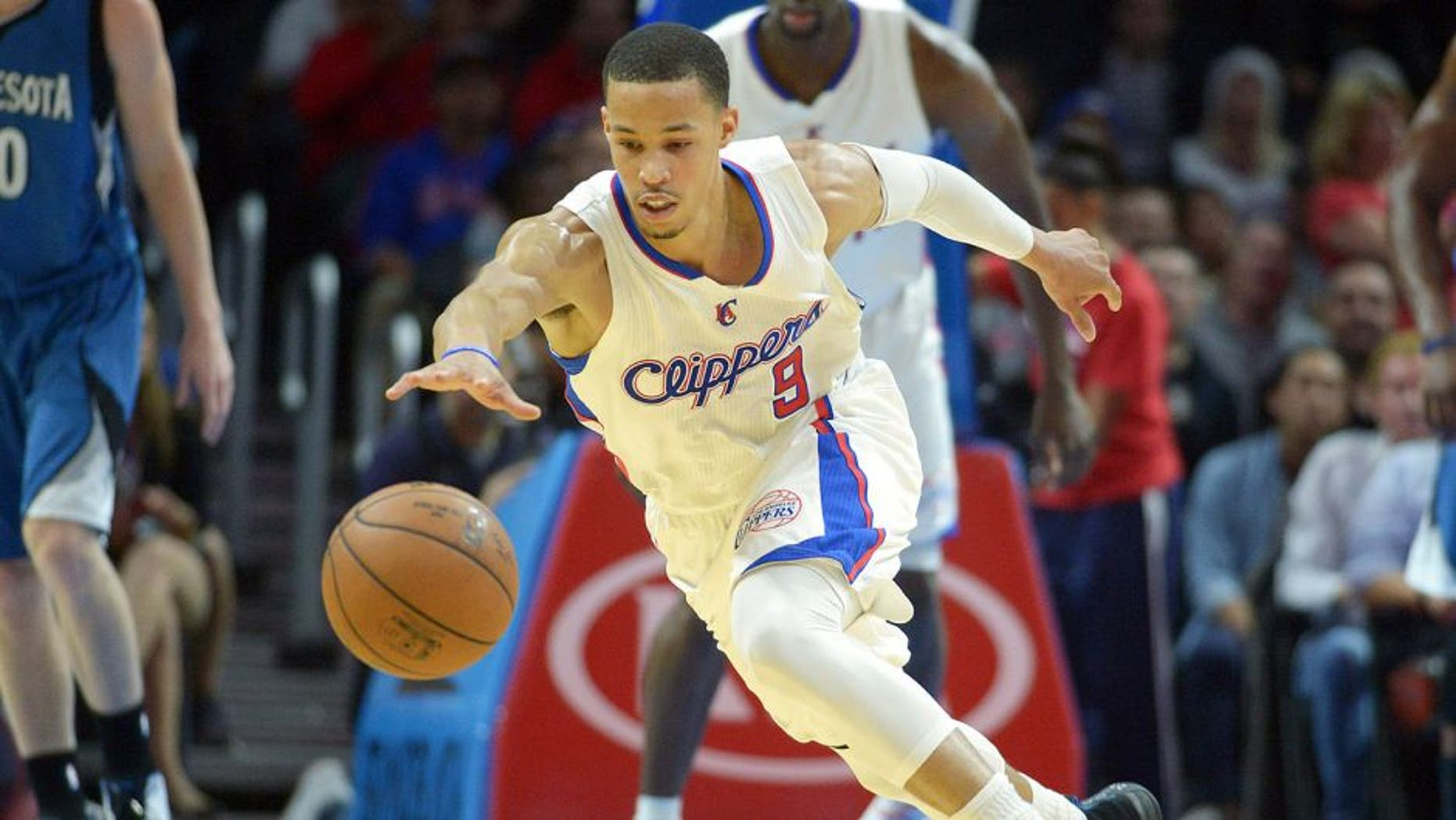 Dec 1, 2014; Los Angeles, CA, USA; Los Angeles Clippers guard Jared Cunningham (9) reaches for the ball against the Minnesota Timberwolves at Staples Center. The Clippers defeated the Timberwolves 127-101. Mandatory Credit: Kirby Lee-USA TODAY Sports