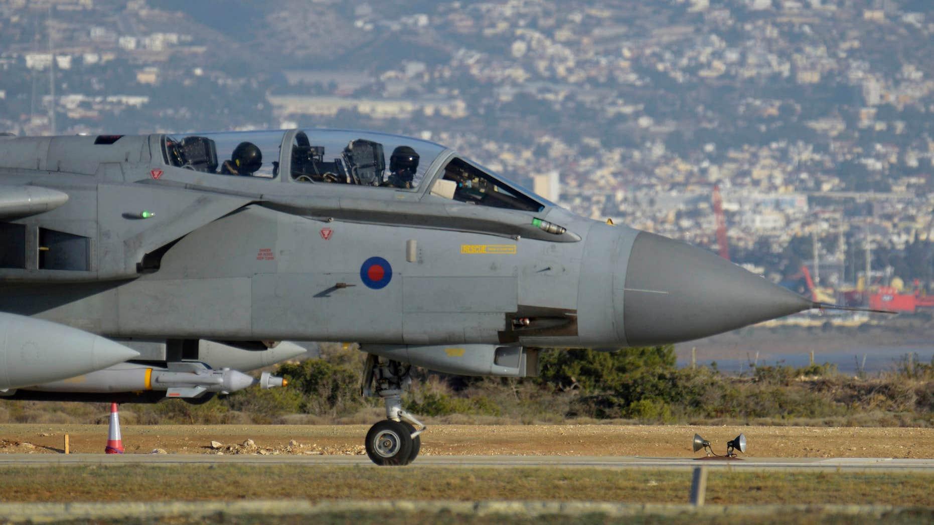Dec. 3, 2015: A British tornado warplane passes on the runway at the RAF Akrotiri, a British air base near costal city of Limassol, Cyprus after an airstrike.