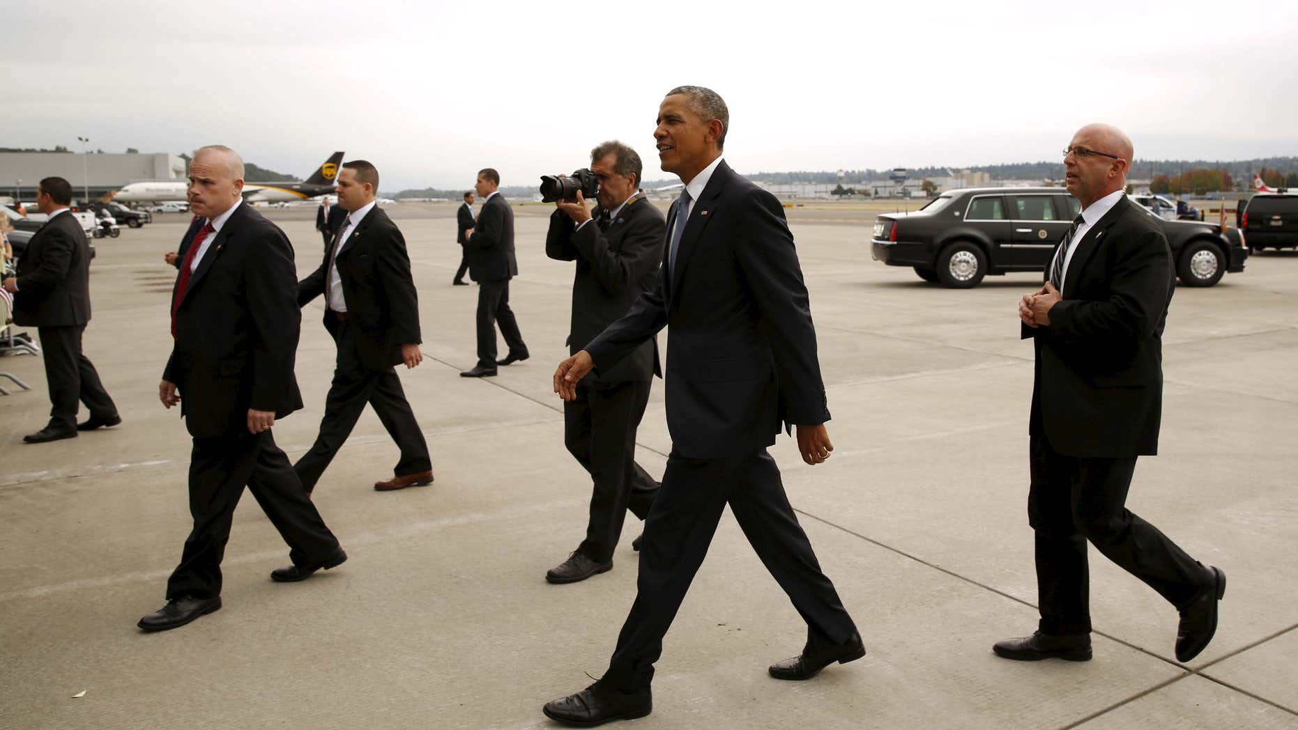 Oct. 9, 2015: Members of the Secret Service escort President Barack Obama to greet supporters upon his arrival in Seattle, Washington.