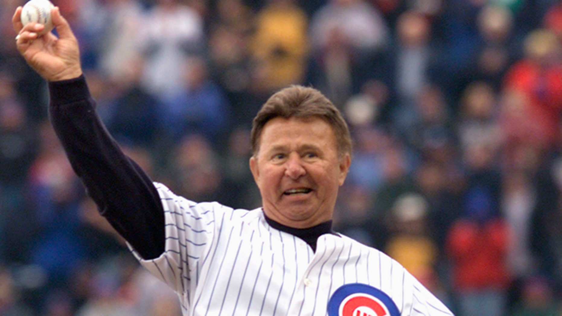 This April 5, 2002, file photo, shows former Chicago Cubs third baseman Ron Santo throwing out the ceremonial first pitch before the Cubs home opener in Chicago.