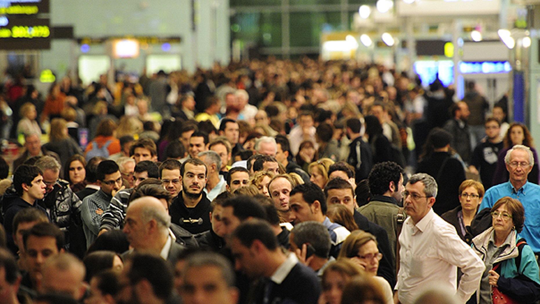 Dec. 3: Passengers wait for news about their flights at T1 terminal of El Prat Llobregat airport in El Prat Llobregat, near Barcelona.