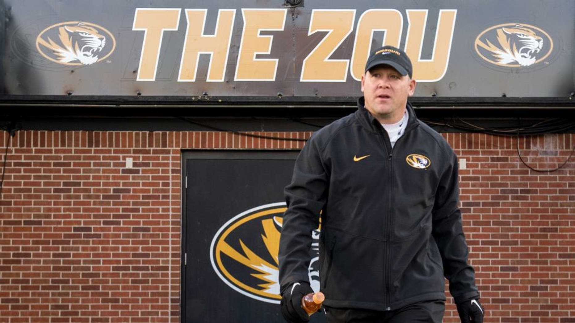 FILE - In this Saturday, Nov. 21, 2015 file photo, Missouri defensive coordinator Barry Odom walks on the field before the start of their NCAA college football game against Tennessee in Columbia, Mo. Missouri has promoted defensive coordinator Barry Odom to replace the retiring Gary Pinkel as head coach. The school said in a release Thursday night, Dec. 3, 2015 that Odom had agreed in principle to a five-year deal that will need to be approved by the school's board of curators next week.(AP Photo/L.G. Patterson, File)