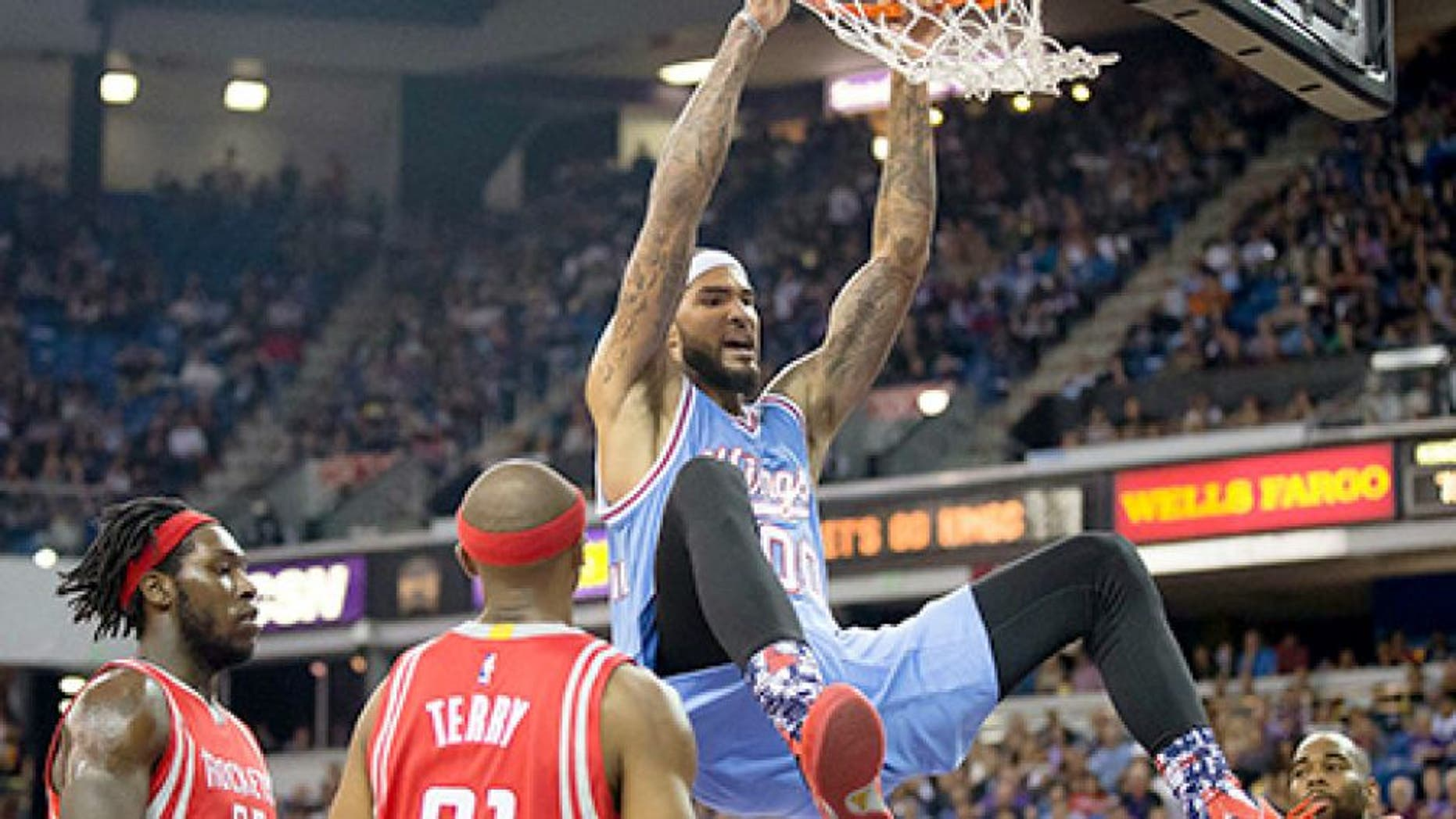 Nov 6, 2015; Sacramento, CA, USA; Sacramento Kings center Willie Cauley-Stein (00) reacts above Houston Rockets forward Montrezl Harrell (35), guard Jason Terry (31) and guard Marcus Thornton (10) after a dunk during the third quarter at Sleep Train Arena. The Houston Rockets defeated the Sacramento Kings 116-110. Mandatory Credit: Kelley L Cox-USA TODAY Sports