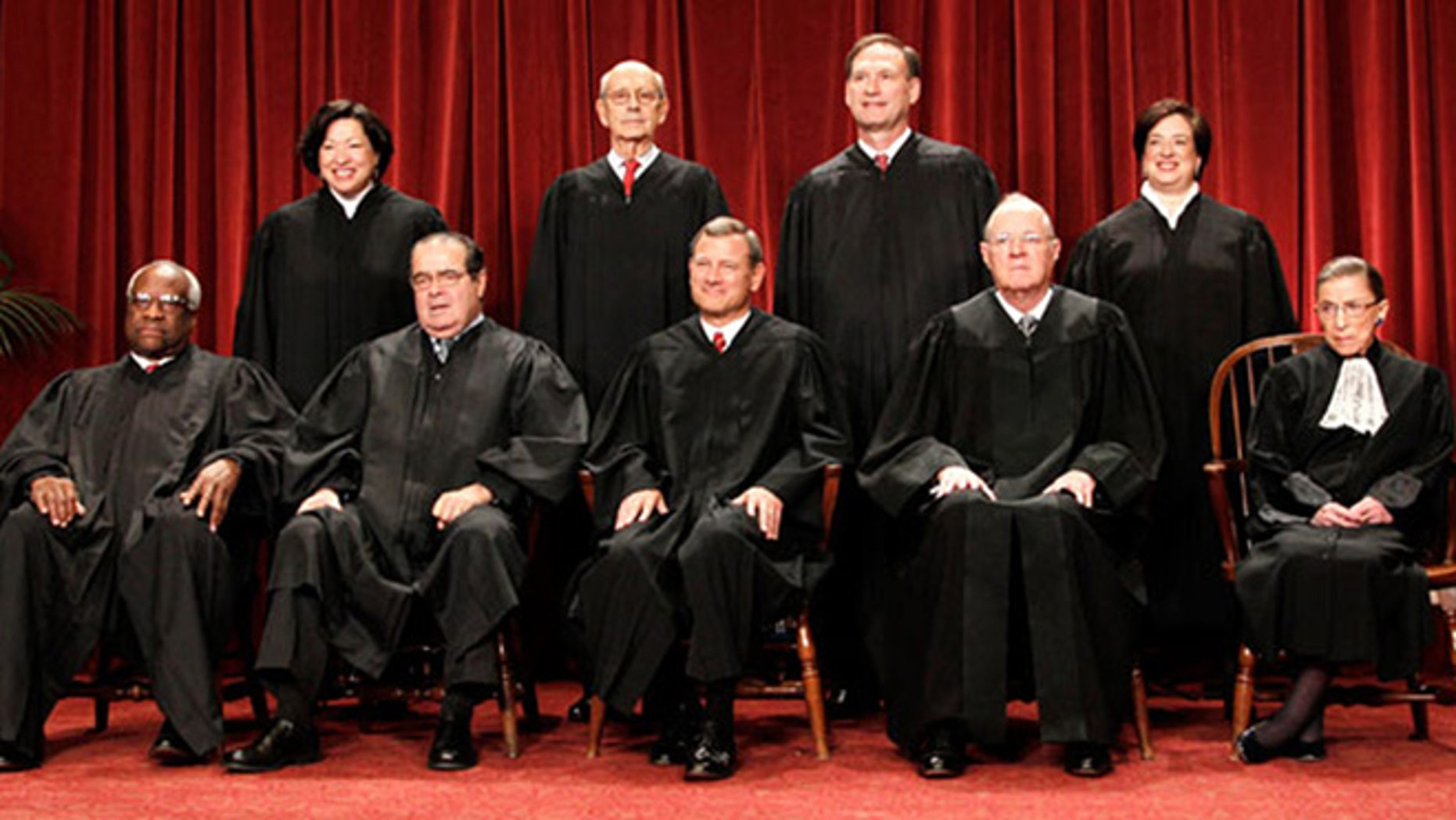 The U.S. Supreme Court justices are pictured.
