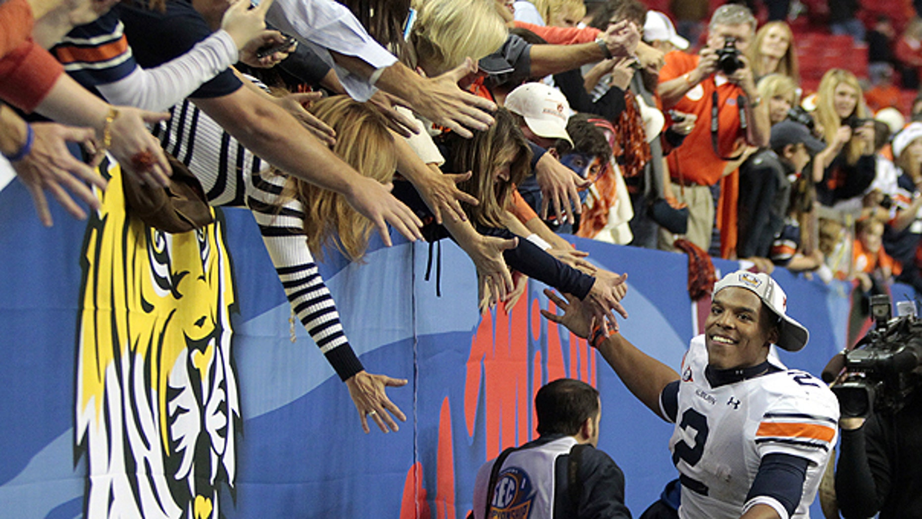 Dec. 4: Auburn quarterback Cameron Newton (2) celebrates with the fans after defeating South Carolina, 56-17, during the Southeastern Conference championship NCAA college football game in Atlanta.