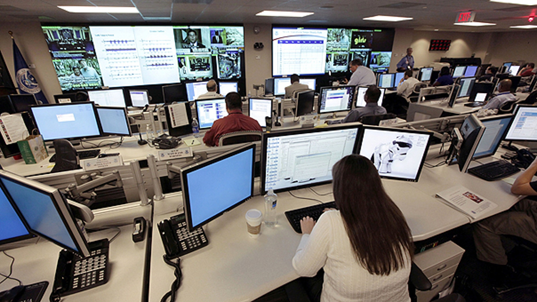 In this Sept. 24, 2010, file photo the National Cybersecurity & Communications Integration Center (NCCIC) prepares for the Cyber Storm III exercise at its operations center in Arlington, Va.