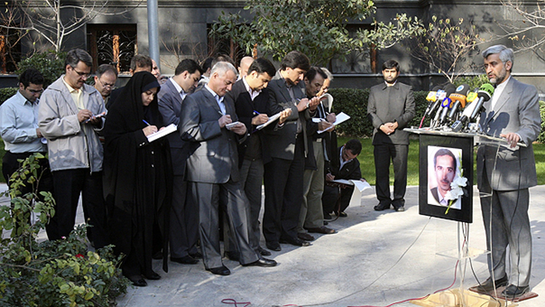 Dec. 4: Iran's top nuclear negotiator Saeed Jalili, right, speaks with media, during a press briefing, in Tehran, Iran.