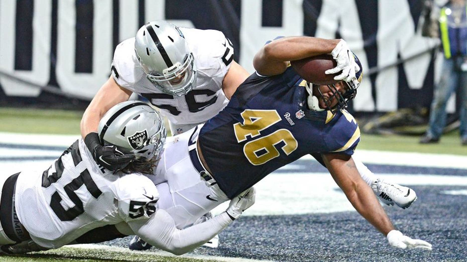 Nov 30, 2014; St. Louis, MO, USA; St. Louis Rams tight end Cory Harkey (46) is tackled into the end zone by Oakland Raiders outside linebacker Sio Moore (55) for a four yard touchdown during the first half at the Edward Jones Dome. Mandatory Credit: Jeff Curry-USA TODAY Sports
