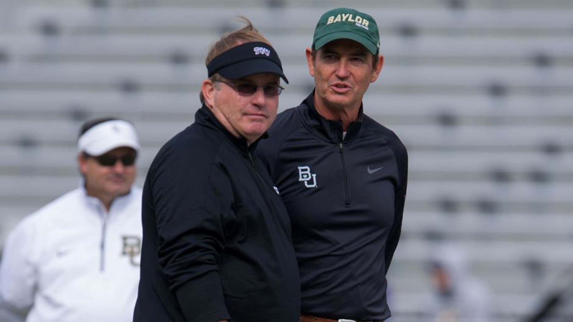 Nov 30, 2013; Fort Worth, TX, USA; TCU Horned Frogs head coach Gary Patterson and Baylor Bears head coach Art Briles before the game at Amon G. Carter Stadium. The Bears defeated the Horned Frogs 41-38. Mandatory Credit: Jerome Miron-USA TODAY Sports