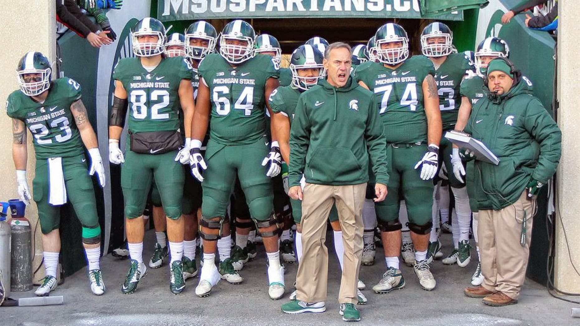 Nov 28, 2015; East Lansing, MI, USA; Michigan State Spartans head coach Mark Dantonio leads his team onto the field prior to a game against the Penn State Nittany Lions at Spartan Stadium. Mandatory Credit: Mike Carter-USA TODAY Sports