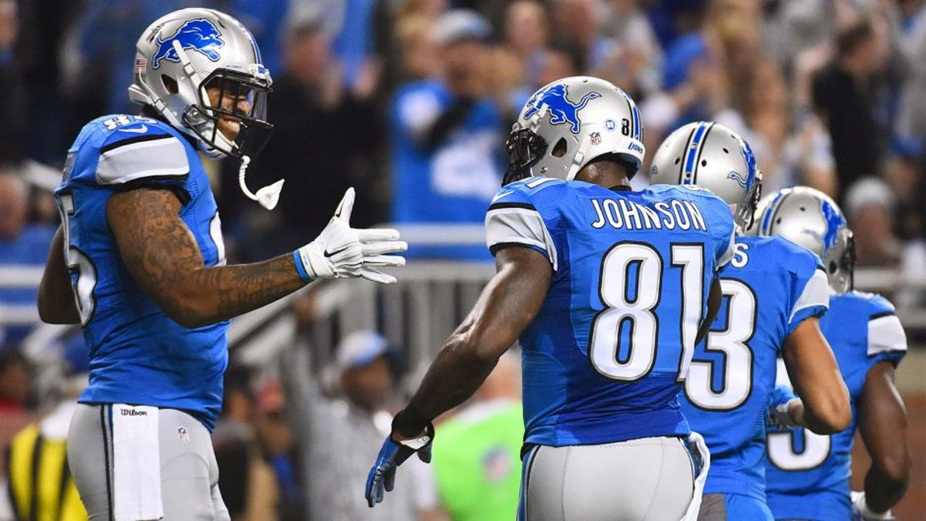 Dec 3, 2015; Detroit, MI, USA; Detroit Lions tight end Eric Ebron (85) celebrates his touchdown with wide receiver Calvin Johnson (81) during the first quarter against the Green Bay Packers at Ford Field. Mandatory Credit: Tim Fuller-USA TODAY Sports