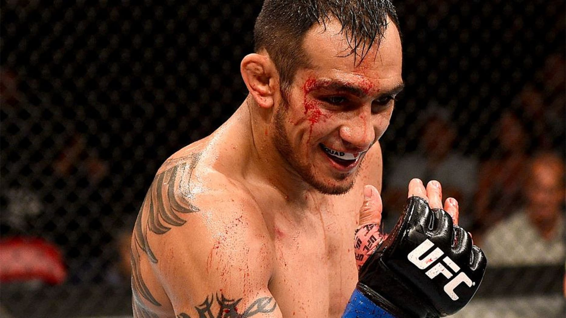 SAN DIEGO, CA - JULY 15: Tony Ferguson taunts Josh Thomson in their lightweight bout during the UFC event at the Valley View Casino Center on July 15, 2015 in San Diego, California. (Photo by Jeff Bottari/Zuffa LLC/Zuffa LLC via Getty Images)