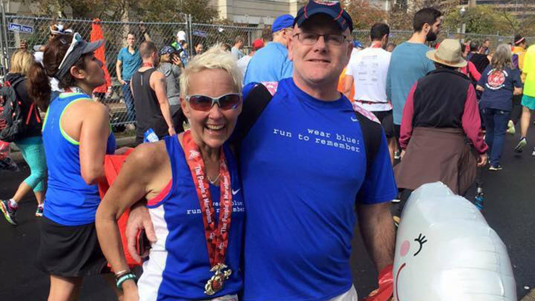 Kim Stemple and her husband, Jim, at the finish of the 2015 Marine Corps Marathon. (image courtesy Kim Stemple)