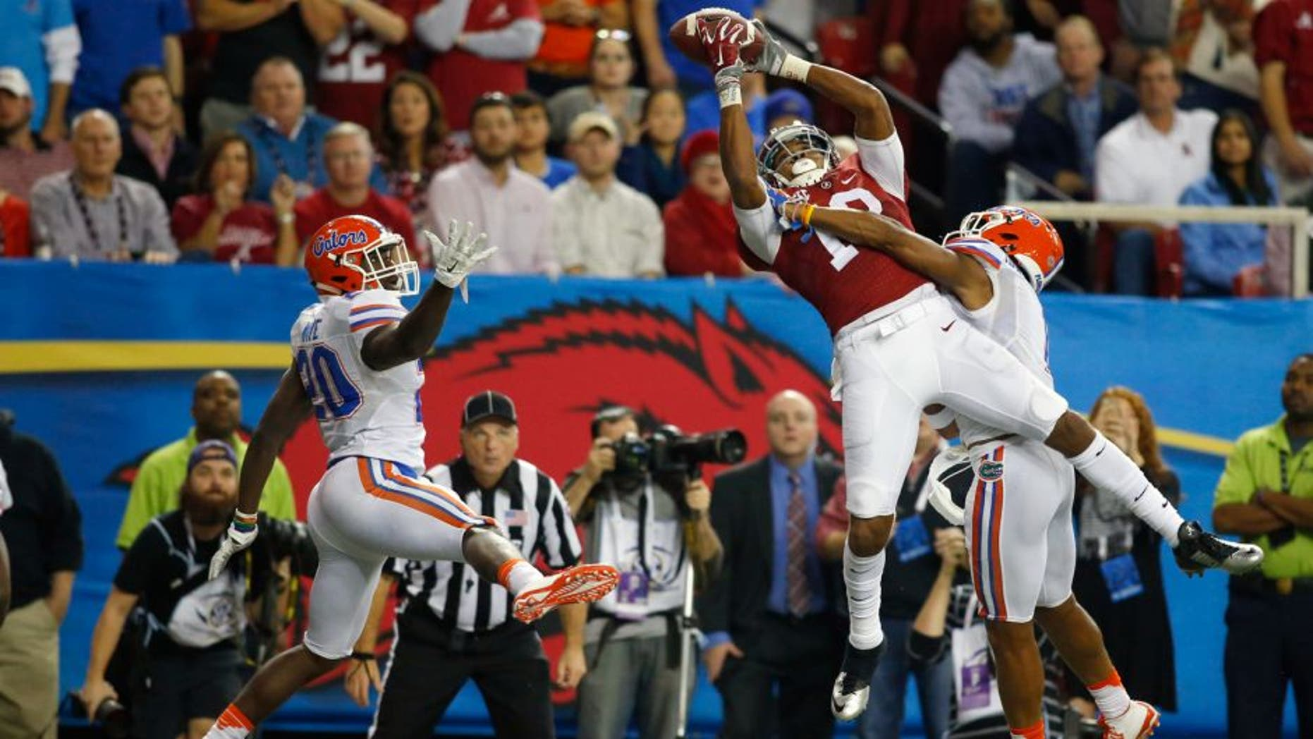 Dec 5, 2015; Atlanta, GA, USA; Alabama Crimson Tide wide receiver ArDarius Stewart (13) catches a 32 yard touchdown pass defended by Florida Gators defensive back Vernon Hargreaves III (1) and Marcus Maye (20) during the third quarter in the 2015 SEC Championship Game at the Georgia Dome. Mandatory Credit: Brett Davis-USA TODAY Sports