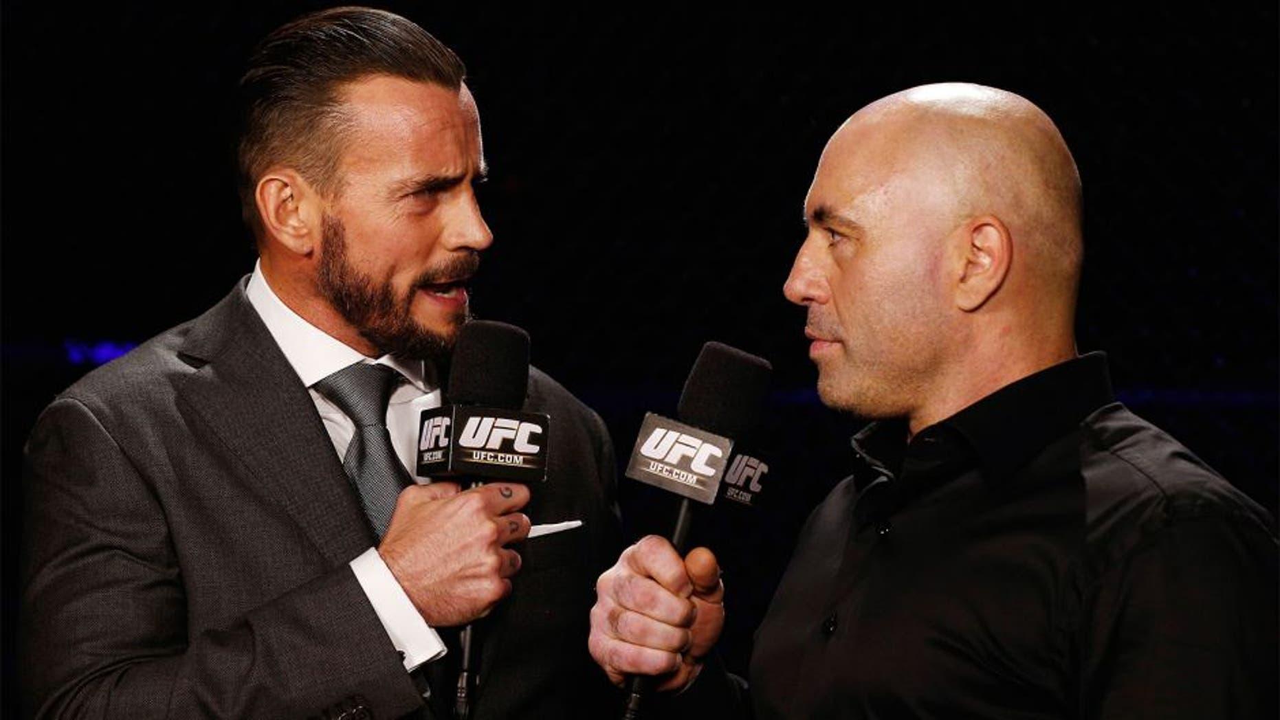 "LAS VEGAS, NV - DECEMBER 06: (L-R) Phil ""CM Punk"" Brooks speaks with Joe Rogan during the UFC 181 event inside the Mandalay Bay Events Center on December 6, 2014 in Las Vegas, Nevada. (Photo by Josh Hedges/Zuffa LLC/Zuffa LLC via Getty Images)"