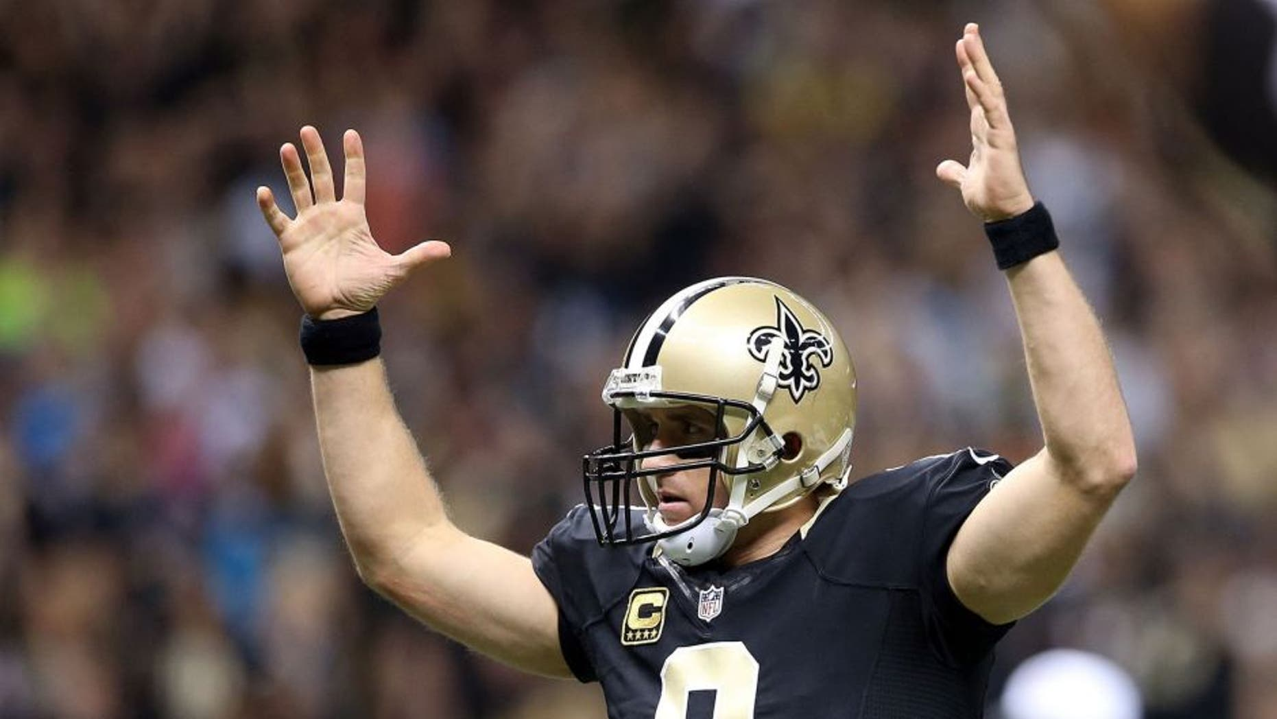 NEW ORLEANS, LA - DECEMBER 06: Drew Brees #9 of the New Orleans Saints celebrates after his team makes a 2 point conversion against the Carolina Panthers at Mercedes-Benz Superdome on December 6, 2015 in New Orleans, Louisiana. (Photo by Sean Gardner/Getty Images)