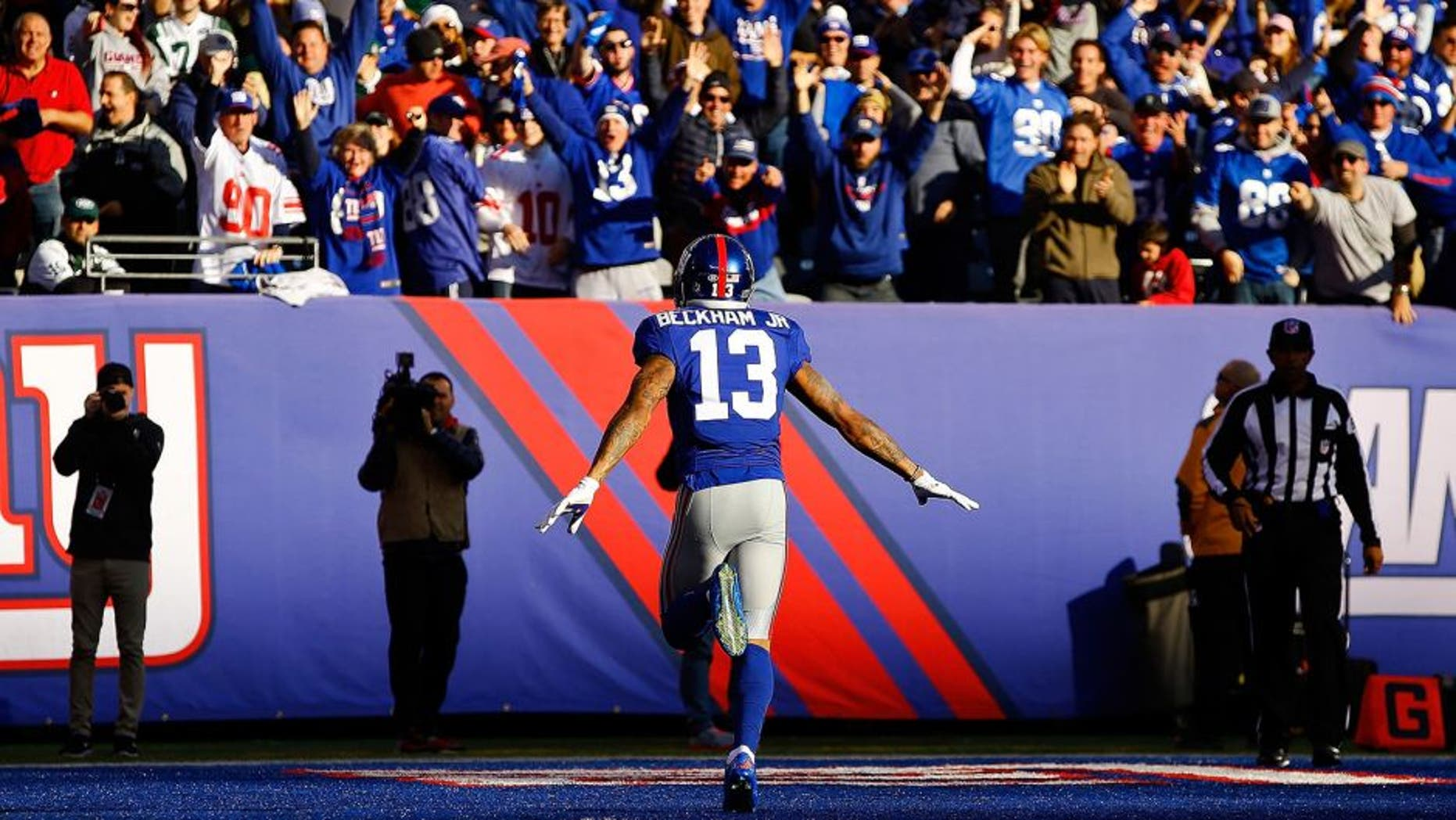 EAST RUTHERFORD, NJ - DECEMBER 06: Odell Beckham Jr. #13 of the New York Giants celebrates after scoring a 72 yard long touchdown against the New York Jets at MetLife Stadium on December 6, 2015 in East Rutherford, New Jersey. (Photo by Al Bello/Getty Images)