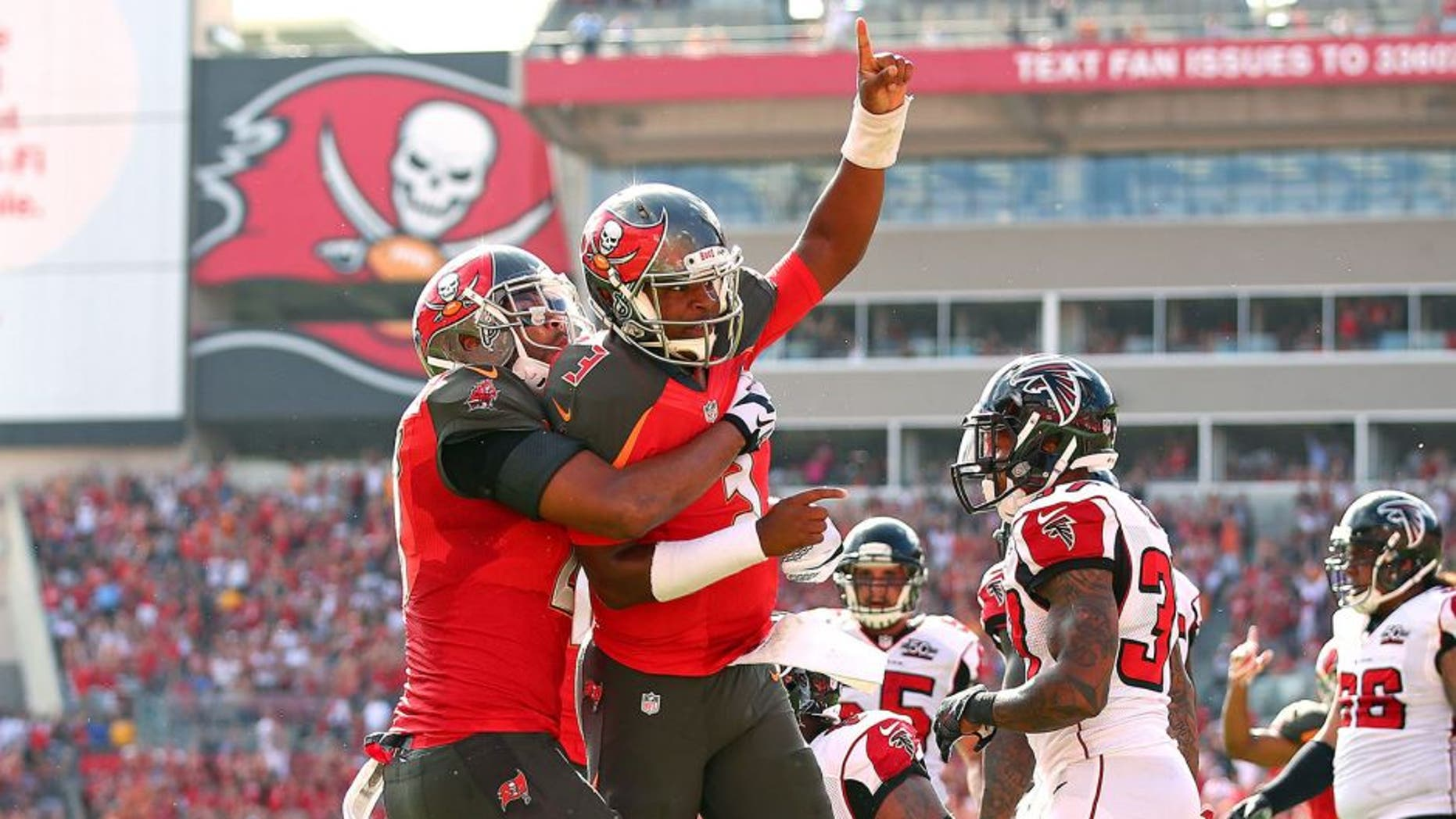 TAMPA, FL - DECEMBER 06: Jameis Winston #3 of the Tampa Bay Buccaneers reacts after scoring a touchdown during the first quarter of the game against the Atlanta Falcons at Raymond James Stadium on December 6, 2015 in Tampa, Florida. (Photo by Rob Foldy/Getty Images)