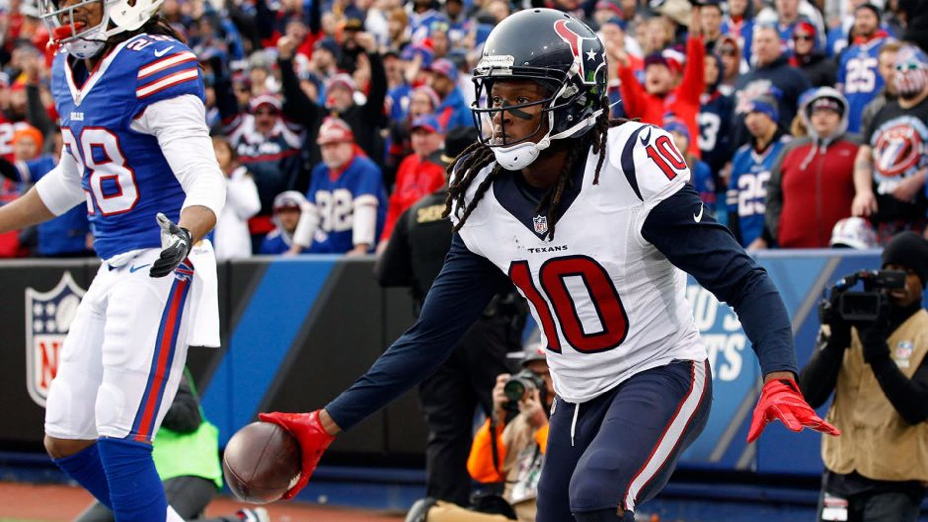 Dec 6, 2015; Orchard Park, NY, USA; Houston Texans wide receiver DeAndre Hopkins (10) celebrates his touchdown catch as Buffalo Bills cornerback Ronald Darby (28) looks on during the second half at Ralph Wilson Stadium. Bills beat the Texans 30-21. Mandatory Credit: Kevin Hoffman-USA TODAY Sports