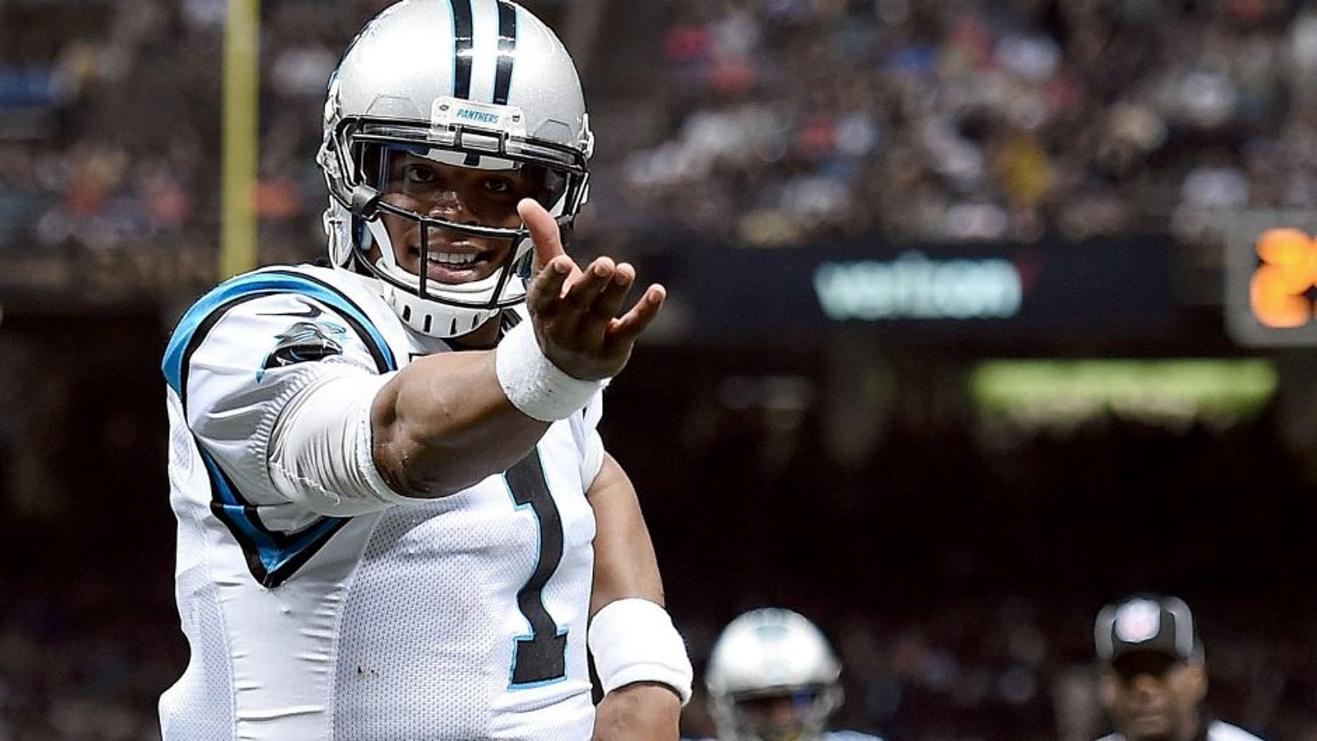 NEW ORLEANS, LA - DECEMBER 06: Cam Newton #1 of the Carolina Panthers celebrates a touchdown during the third quarter of a game against the New Orleans Saints at the Mercedes-Benz Superdome on December 6, 2015 in New Orleans, Louisiana. (Photo by Stacy Revere/Getty Images)