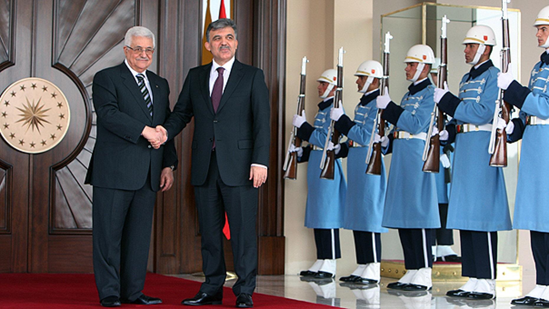 Palestinian leader Mahmoud Abbas, left, and Turkish President Abdullah Gul pose for media cameras before their meeting at the Cankaya Palace in Ankara, Turkey.