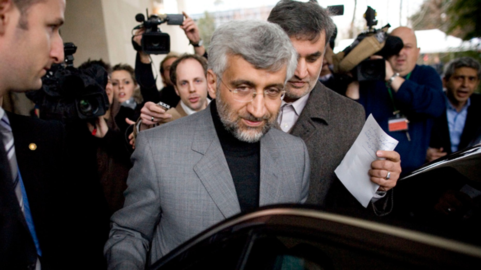 Dec. 7: Iran's chief negotiator Saeed Jalili, center, enters his car after a brief interview with Iranian Television in Geneva, Switzerland.