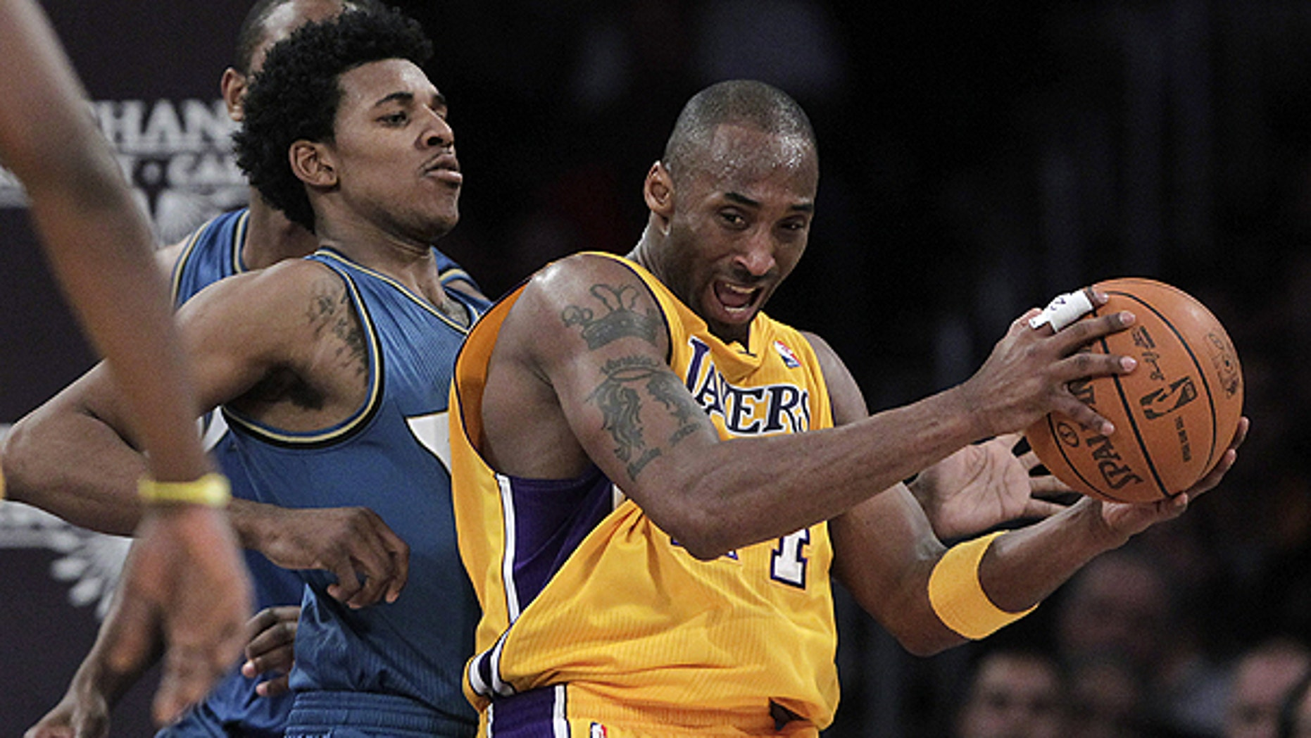 Dec. 7: Los Angeles Lakers guard Kobe Bryant, right, is pressured by Washington Wizards guard Nick Young during the first half of an NBA basketball game in Los Angeles.