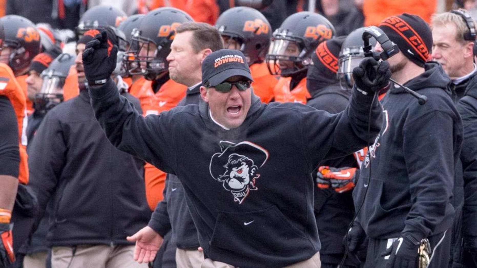 Dec 7, 2013; Stillwater, OK, USA; Oklahoma State Cowboys head coach Mike Gundy reacts to a call during the third quarter against the Oklahoma Sooners at Boone Pickens Stadium. Mandatory Credit: Richard Rowe-USA TODAY Sports