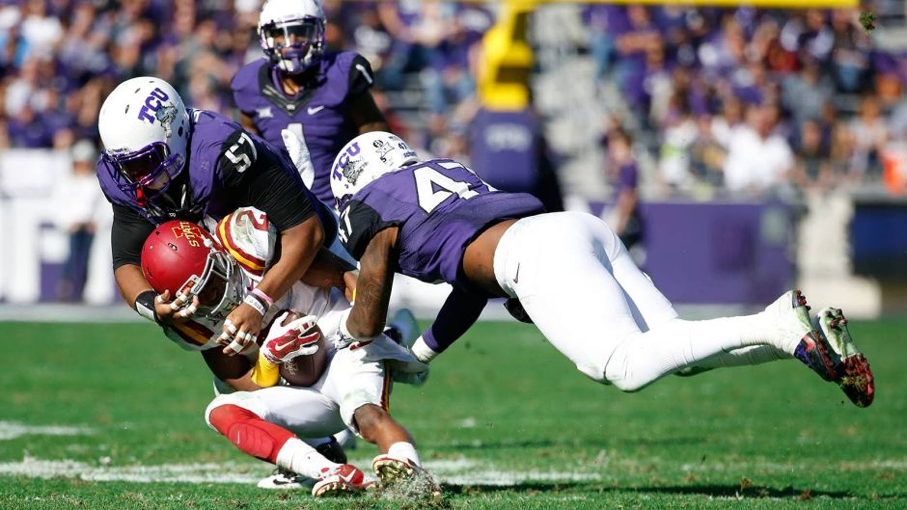 Dec 6, 2014; Fort Worth, TX, USA; TCU Horned Frogs defensive tackle Davion Pierson (57) and linebacker Paul Dawson (47) tackle Iowa State Cyclones running back Aaron Wimberly (2) during the game at Amon G. Carter Stadium. Mandatory Credit: Kevin Jairaj-USA TODAY Sports