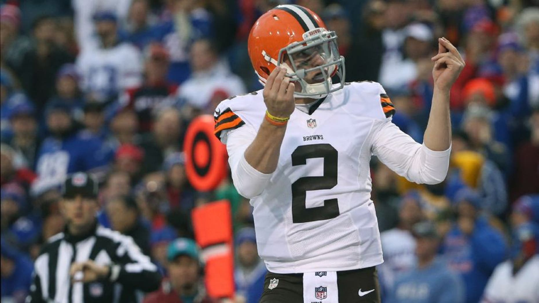 ORCHARD PARK, NY - NOVEMBER 30: Johnny Manziel #2 of the Cleveland Browns celebrates after scoring a touchdown during NFL game action against the Buffalo Bills at Ralph Wilson Stadium on November 30, 2014 in Orchard Park, New York. (Photo by Tom Szczerbowski/Getty Images)