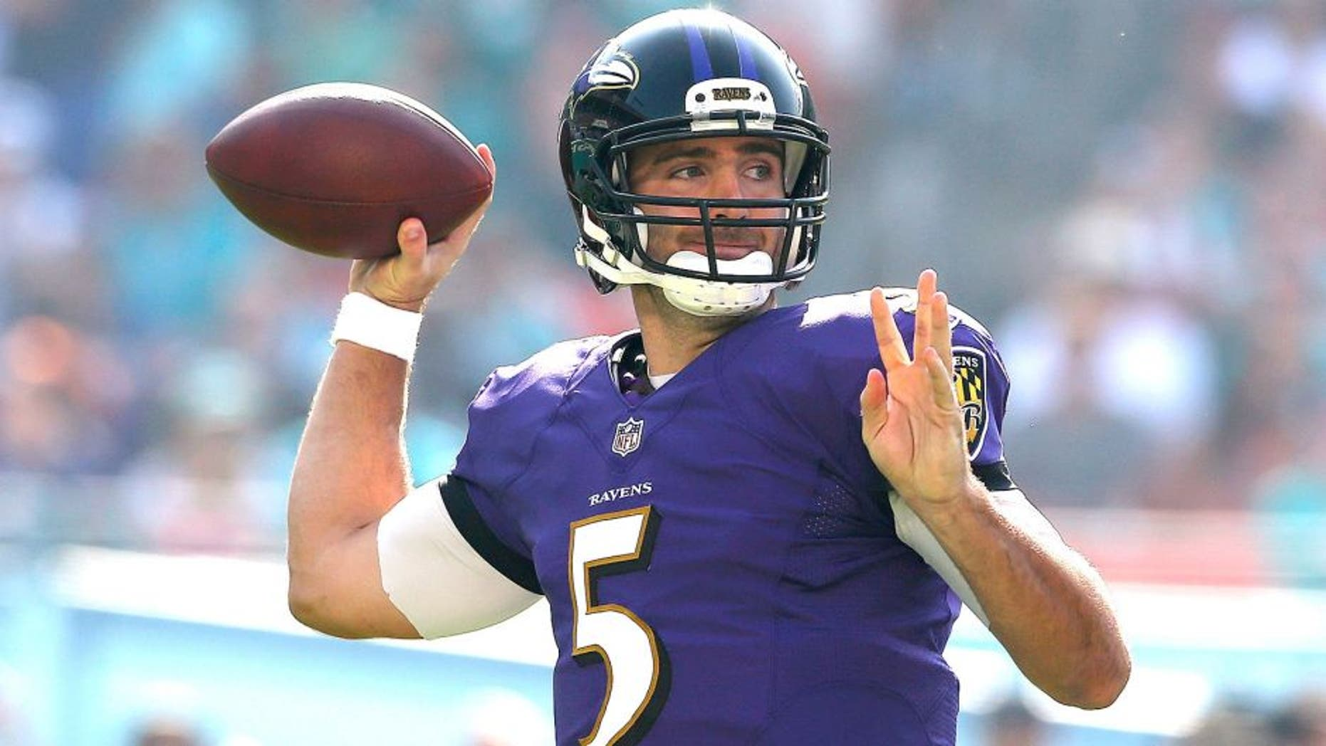 MIAMI GARDENS, FL - DECEMBER 07: Quarterback Joe Flacco #5 of the Baltimore Ravens throws against the Miami Dolphins in the second quarter during a game at Sun Life Stadium on December 7, 2014 in Miami Gardens, Florida. (Photo by Mike Ehrmann/Getty Images)