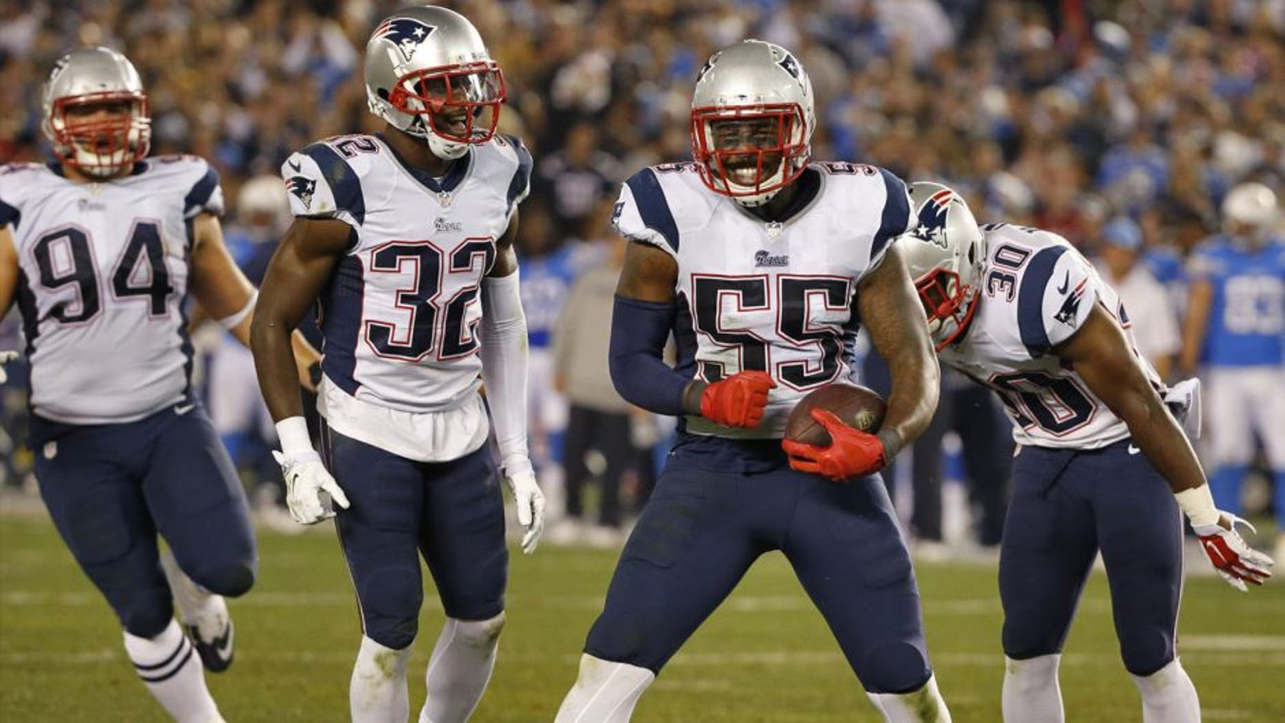New England Patriots outside linebacker Akeem Ayers (55) celebrates his interception against the San Diego Chargers during the second half in an NFL football game Sunday, Dec. 7, 2014, in San Diego. (AP Photo/Lenny Ignelzi)