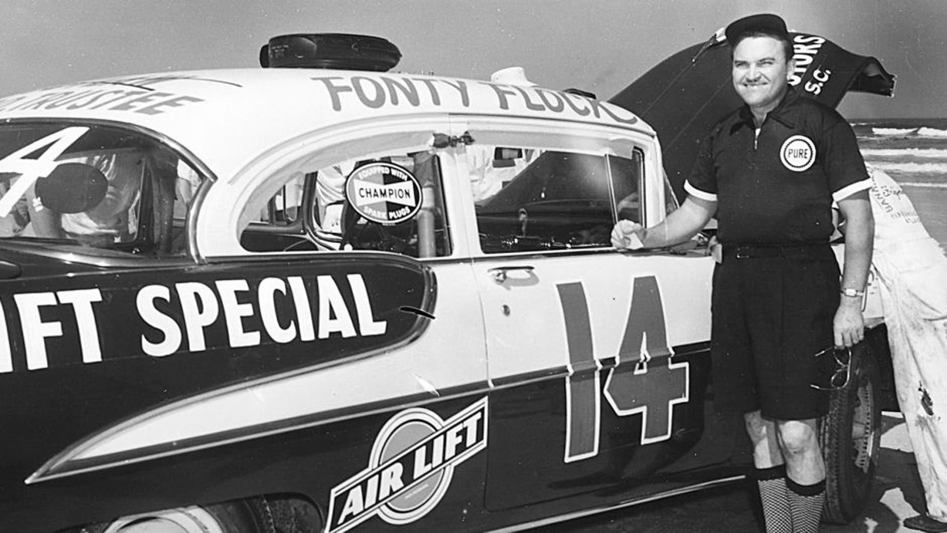 DAYTONA BEACH, FL - 1955: Fonty Flock with Frank Christian's 1955 Air Lift Special Oldsmobile at the Daytona Beach-Road Course in 1955. Flock finished fifth in the Grand National race that year. (Photo by ISC Archives via Getty Images)
