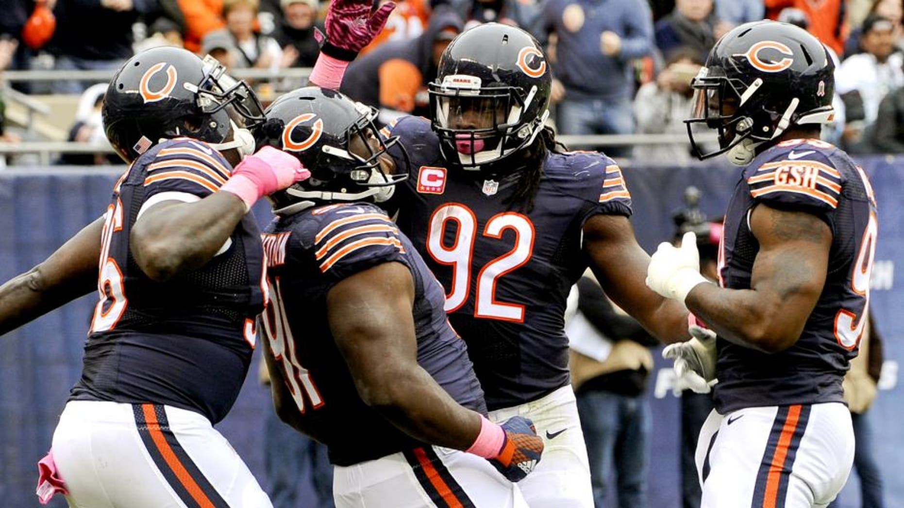 Oct 4, 2015; Chicago, IL, USA; Chicago Bears nose tackle Eddie Goldman (91) celebrates with Chicago Bears defensive end Jarvis Jenkins (96), Chicago Bears outside linebacker Pernell McPhee (92) and Chicago Bears linebacker Lamarr Houston (99) after he sacked Oakland Raiders quarterback Derek Carr (4) in the first half at Soldier Field. Mandatory Credit: Matt Marton-USA TODAY Sports