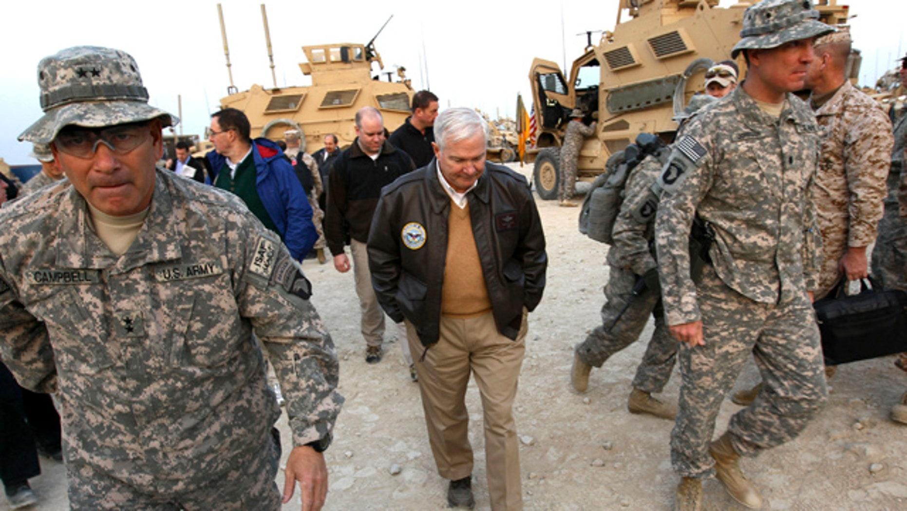 Dec. 7: Defense Secretary Robert Gates walks with Maj. Gen. John Campbell, left,, commanding general of the 101st Air Assault, in Kunar Province, Afghanistan in Afghanistan.