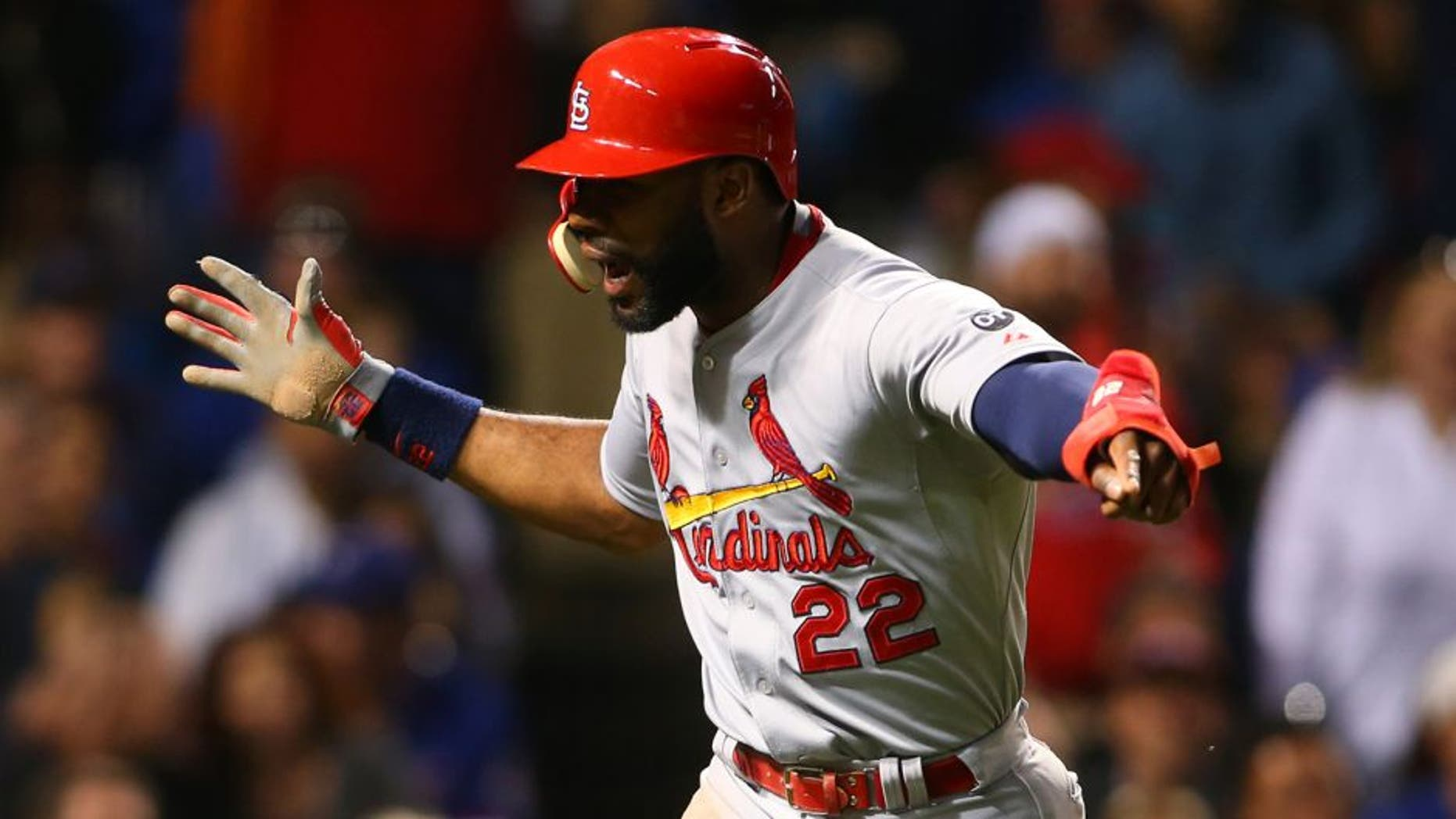 Jul 7, 2015; Chicago, IL, USA; St. Louis Cardinals right fielder Jason Heyward (22) celebrates after scoring during the sixth inning in game two of a baseball doubleheader against the Chicago Cubs at Wrigley Field. Mandatory Credit: Caylor Arnold-USA TODAY Sports