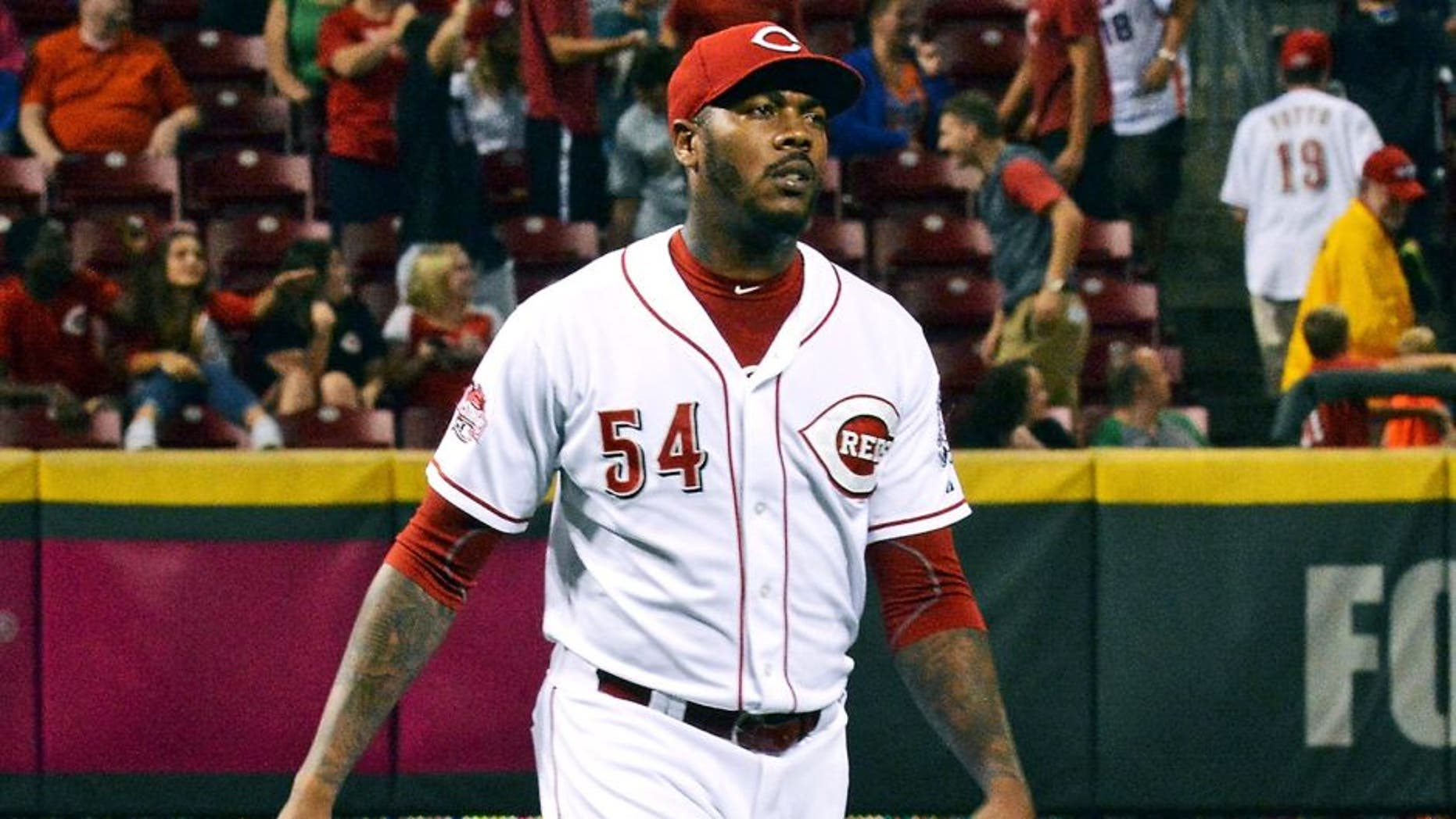 CINCINNATI, OH - SEPTEMBER 25: Aroldis Chapman #54 of the Cincinnati Reds walks to the mound to pitch in the ninth inning against the New York Mets with an image of his face on the scoreboard behind him at Great American Ball Park on September 25, 2015 in Cincinnati, Ohio. New York defeated Cincinnati 12-5. (Photo by Jamie Sabau/Getty Images)
